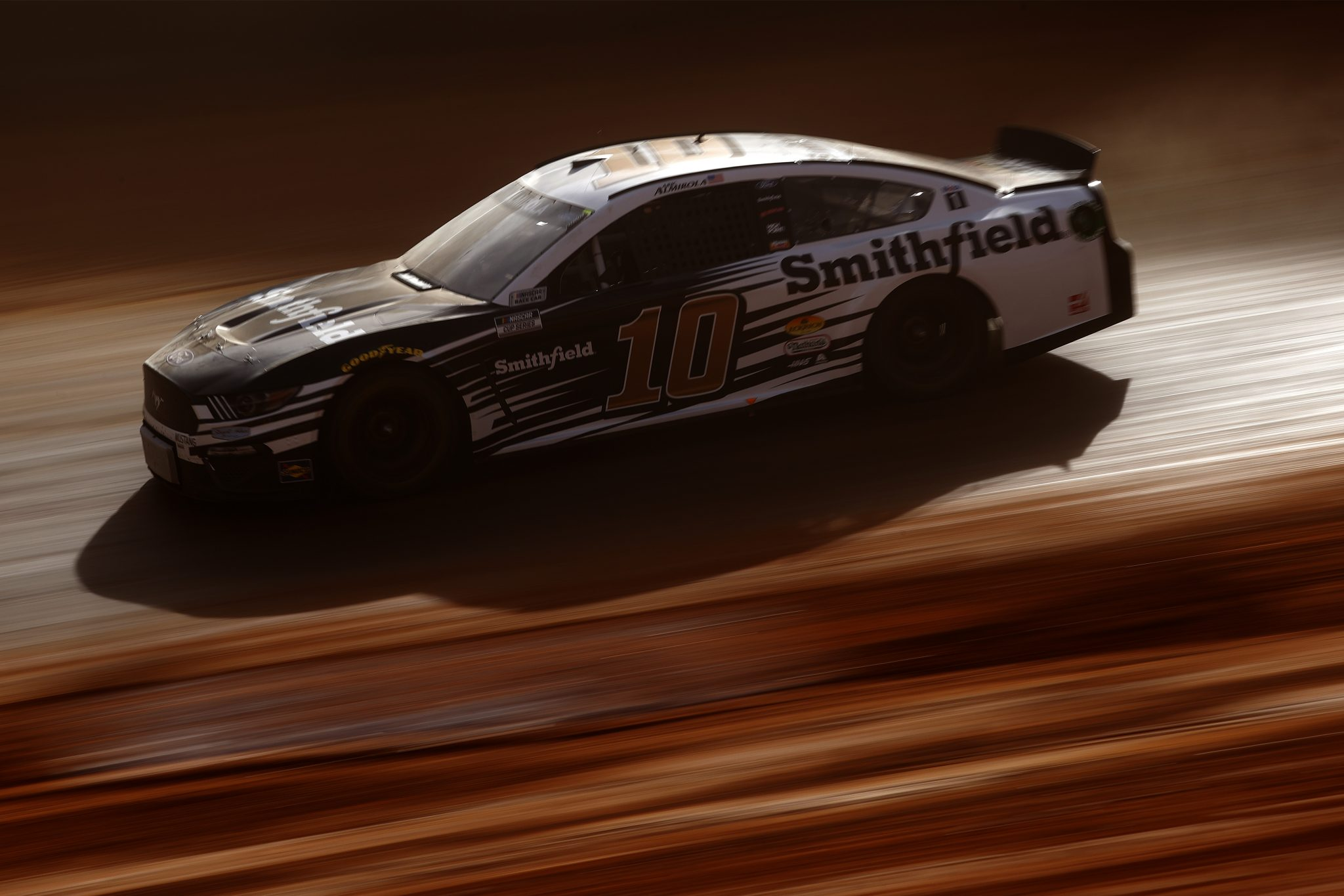 BRISTOL, TENNESSEE - MARCH 26: Aric Almirola, driver of the #10 Smithfield Ford, drives during practice for the NASCAR Cup Series Food City Dirt Race at Bristol Motor Speedway on March 26, 2021 in Bristol, Tennessee. (Photo by Chris Graythen/Getty Images) | Getty Images