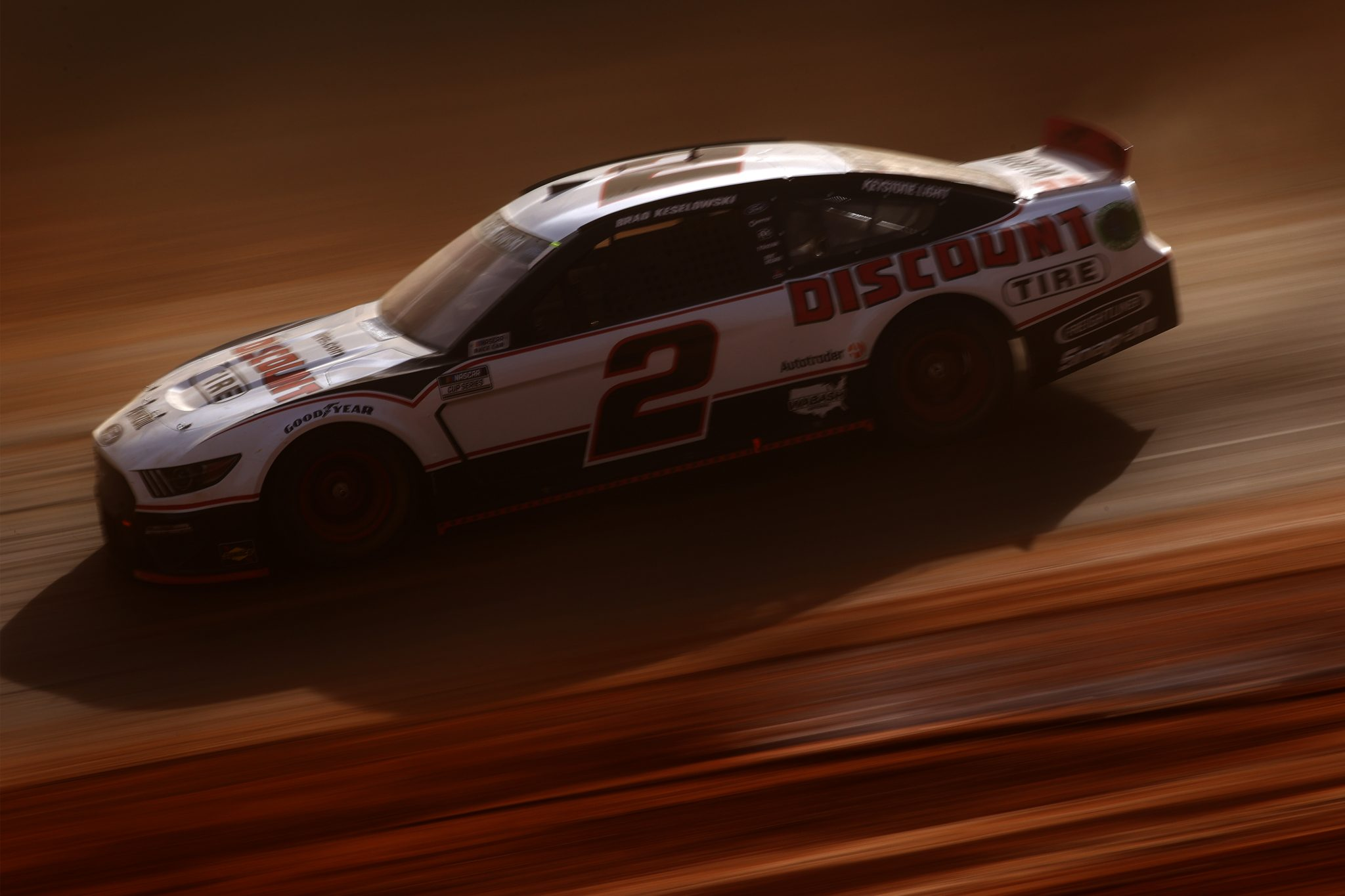 BRISTOL, TENNESSEE - MARCH 26: Brad Keselowski, driver of the #2 Discount Tire Ford, drives during practice for the NASCAR Cup Series Food City Dirt Race at Bristol Motor Speedway on March 26, 2021 in Bristol, Tennessee. (Photo by Chris Graythen/Getty Images)   Getty Images