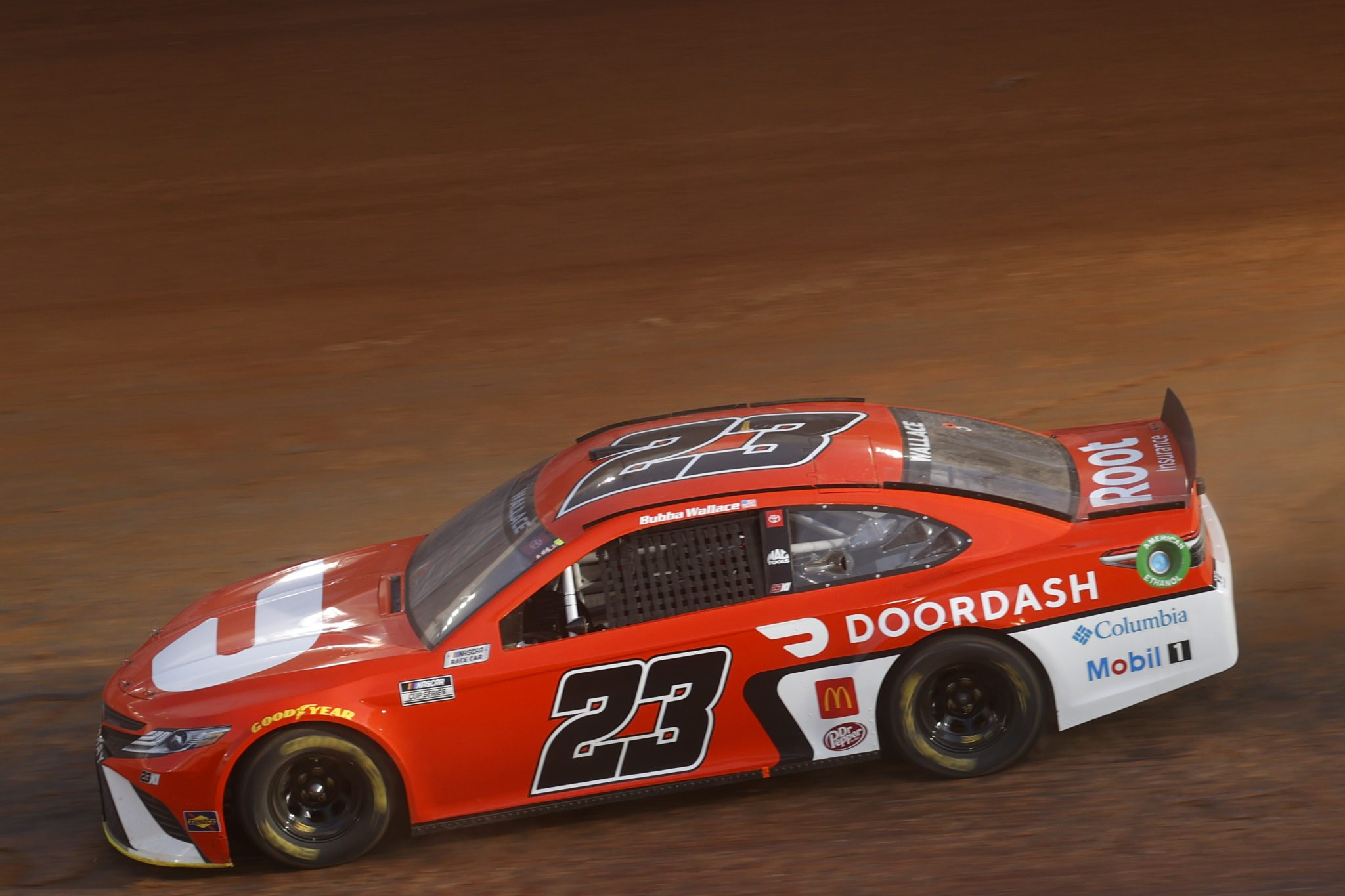 BRISTOL, TENNESSEE - MARCH 26: Bubba Wallace, driver of the #23 DoorDash Toyota, drives during practice for the NASCAR Cup Series Food City Dirt Race at Bristol Motor Speedway on March 26, 2021 in Bristol, Tennessee. (Photo by Chris Graythen/Getty Images) | Getty Images