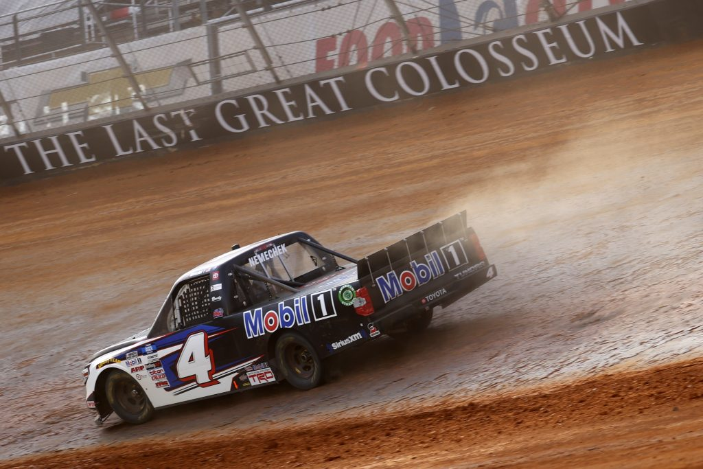 BRISTOL, TENNESSEE - MARCH 26: John Hunter Nemechek, driver of the #4 Mobil 1 Toyota, drives during practice for the NASCAR Camping World Truck Series Pinty's Truck Race on Dirt at Bristol Motor Speedway on March 26, 2021 in Bristol, Tennessee. (Photo by Chris Graythen/Getty Images) | Getty Images