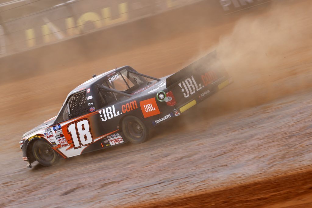 BRISTOL, TENNESSEE - MARCH 26: Chandler Smith, driver of the #18 JBL Toyota, drives during practice for the NASCAR Camping World Truck Series Pinty's Truck Race on Dirt at Bristol Motor Speedway on March 26, 2021 in Bristol, Tennessee. (Photo by Chris Graythen/Getty Images) | Getty Images