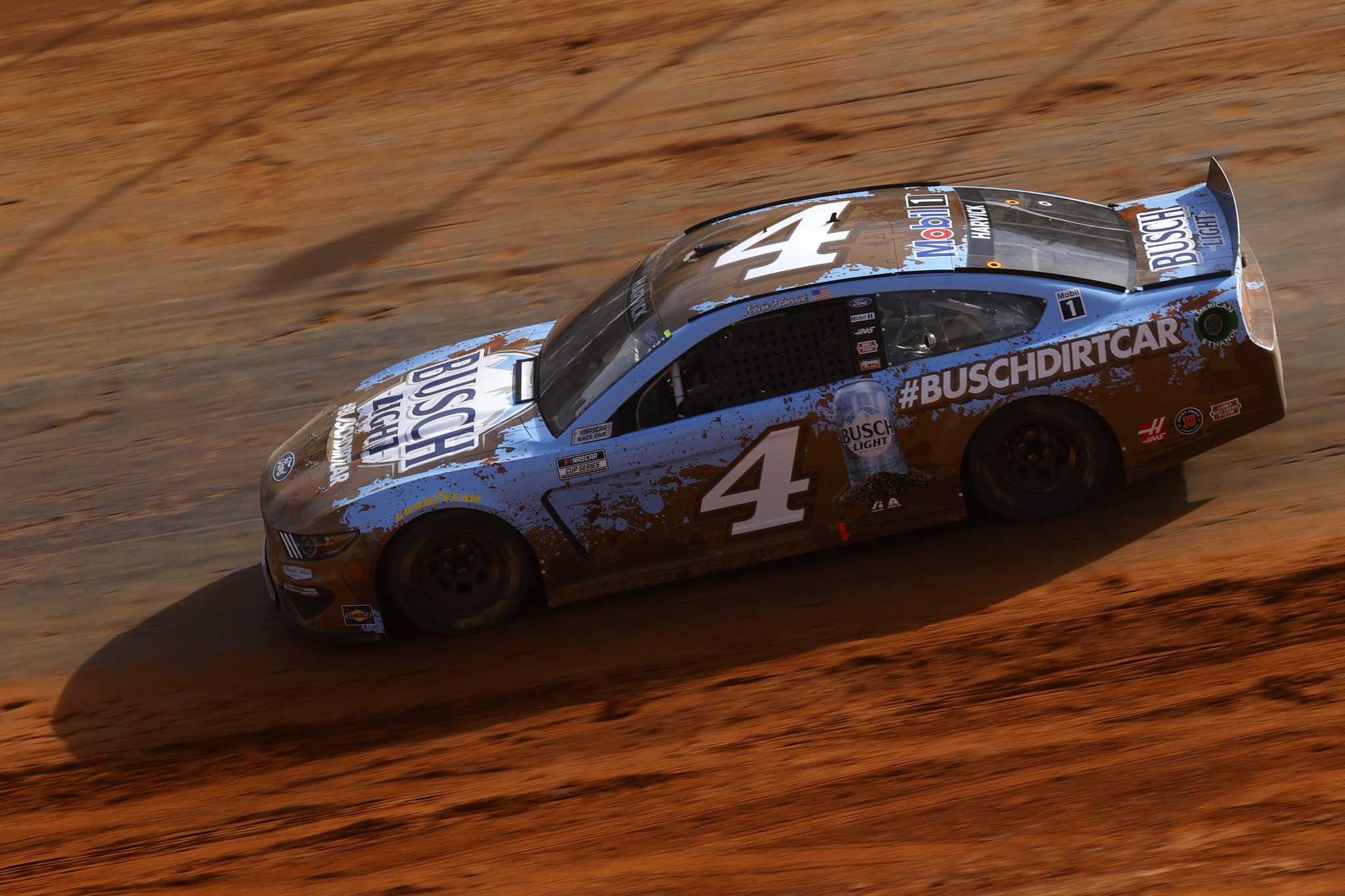 BRISTOL, TENNESSEE - MARCH 26: Kevin Harvick, driver of the #4 Busch Light Ford, drives during practice for the NASCAR Cup Series Food City Dirt Race at Bristol Motor Speedway on March 26, 2021 in Bristol, Tennessee. (Photo by Chris Graythen/Getty Images) | Getty Images