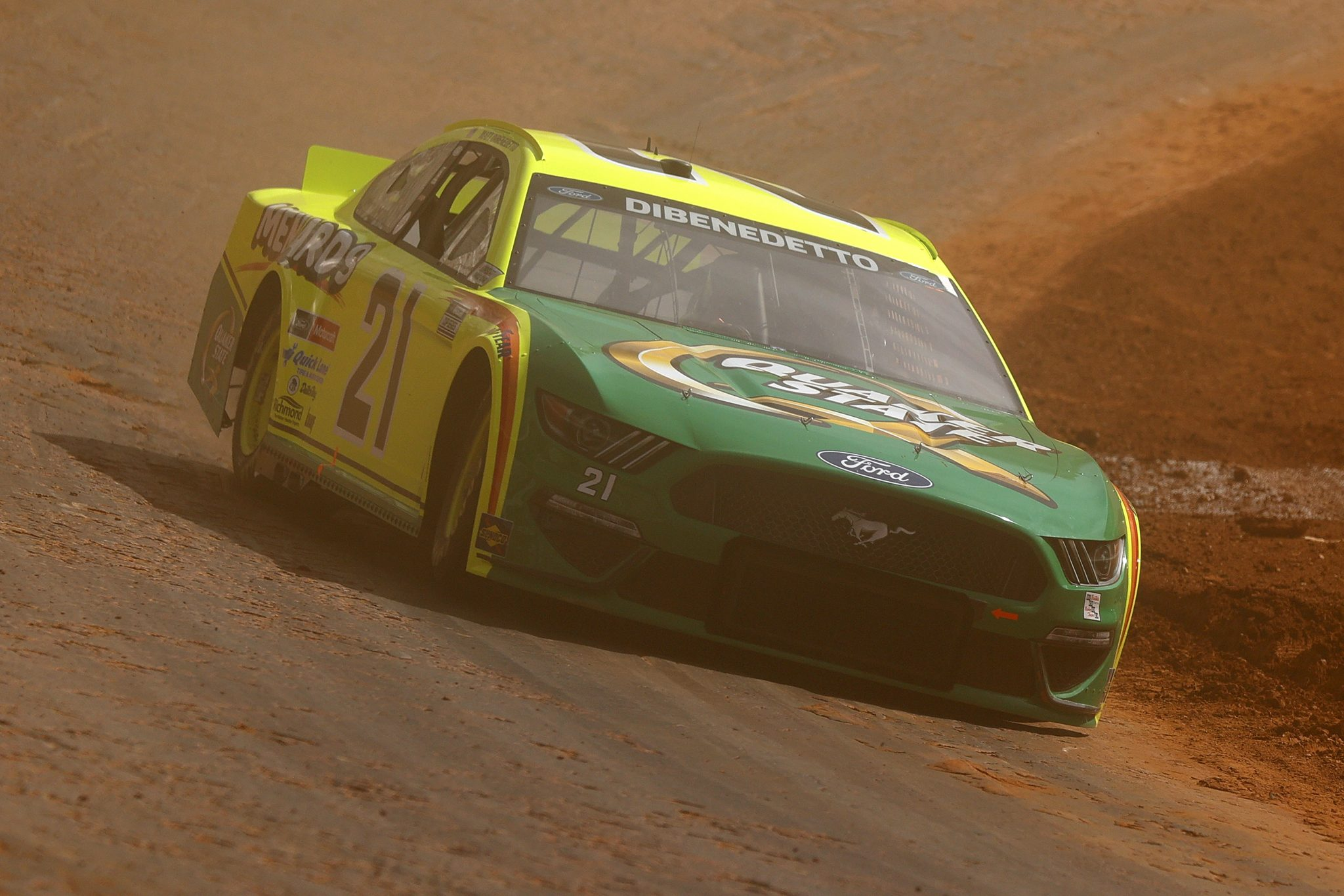 BRISTOL, TENNESSEE - MARCH 26: Matt DiBenedetto, driver of the #21 Menards/Quaker State Ford, Drives during practice for the NASCAR Cup Series Food City Dirt Race at Bristol Motor Speedway on March 26, 2021 in Bristol, Tennessee. (Photo by Jared C. Tilton/Getty Images) | Getty Images