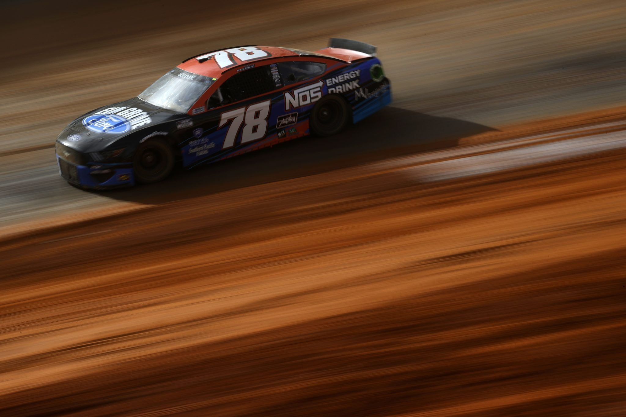 BRISTOL, TENNESSEE - MARCH 26: Shane Golobic, driver of the #78 Elk Grove Ford/NOS Energy Ford, drives during practice for the NASCAR Cup Series Food City Dirt Race at Bristol Motor Speedway on March 26, 2021 in Bristol, Tennessee. (Photo by Chris Graythen/Getty Images) | Getty Images