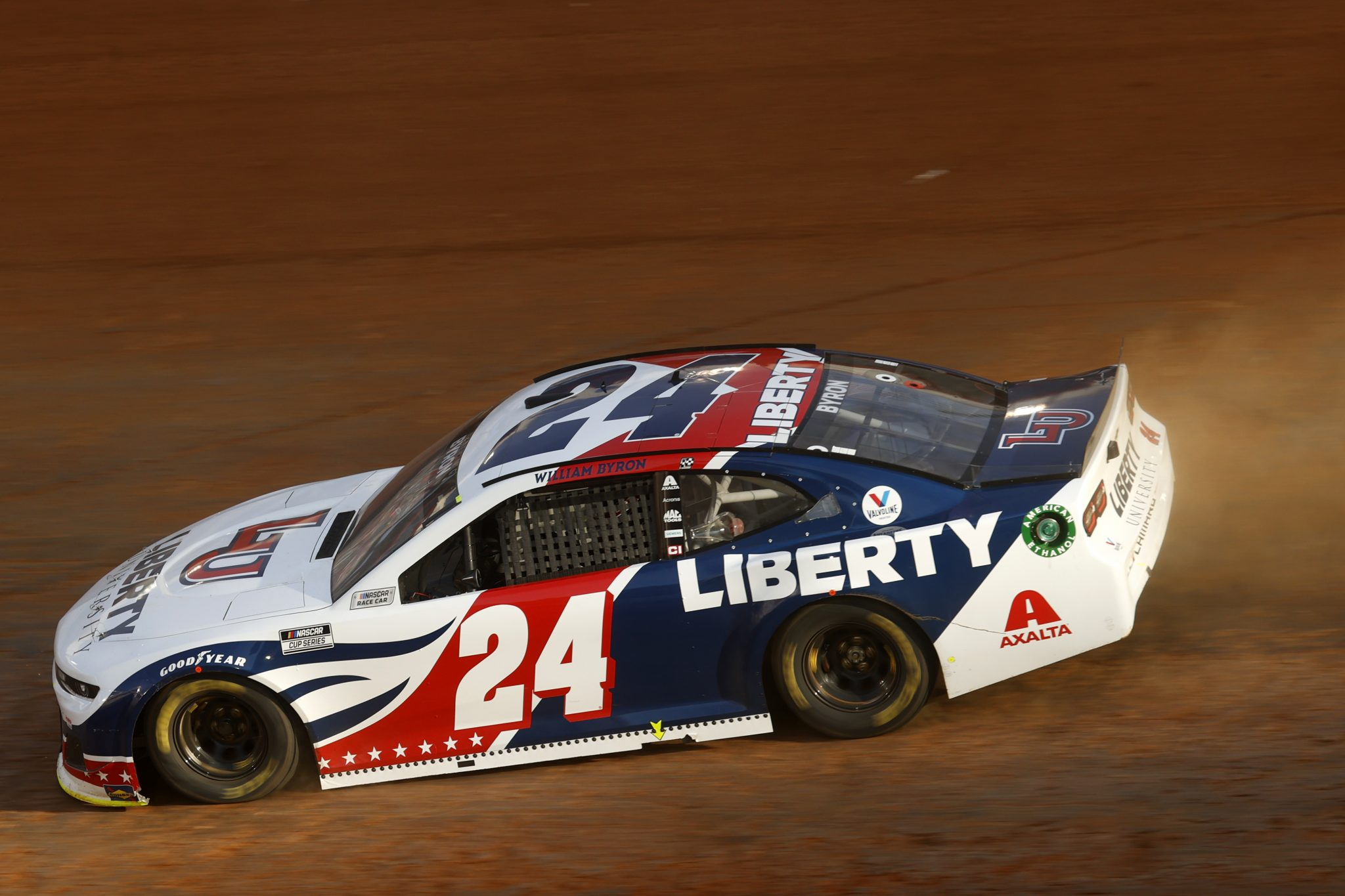 BRISTOL, TENNESSEE - MARCH 26: William Byron, driver of the #24 Liberty University Chevrolet, drives during practice for the NASCAR Cup Series Food City Dirt Race at Bristol Motor Speedway on March 26, 2021 in Bristol, Tennessee. (Photo by Chris Graythen/Getty Images) | Getty Images