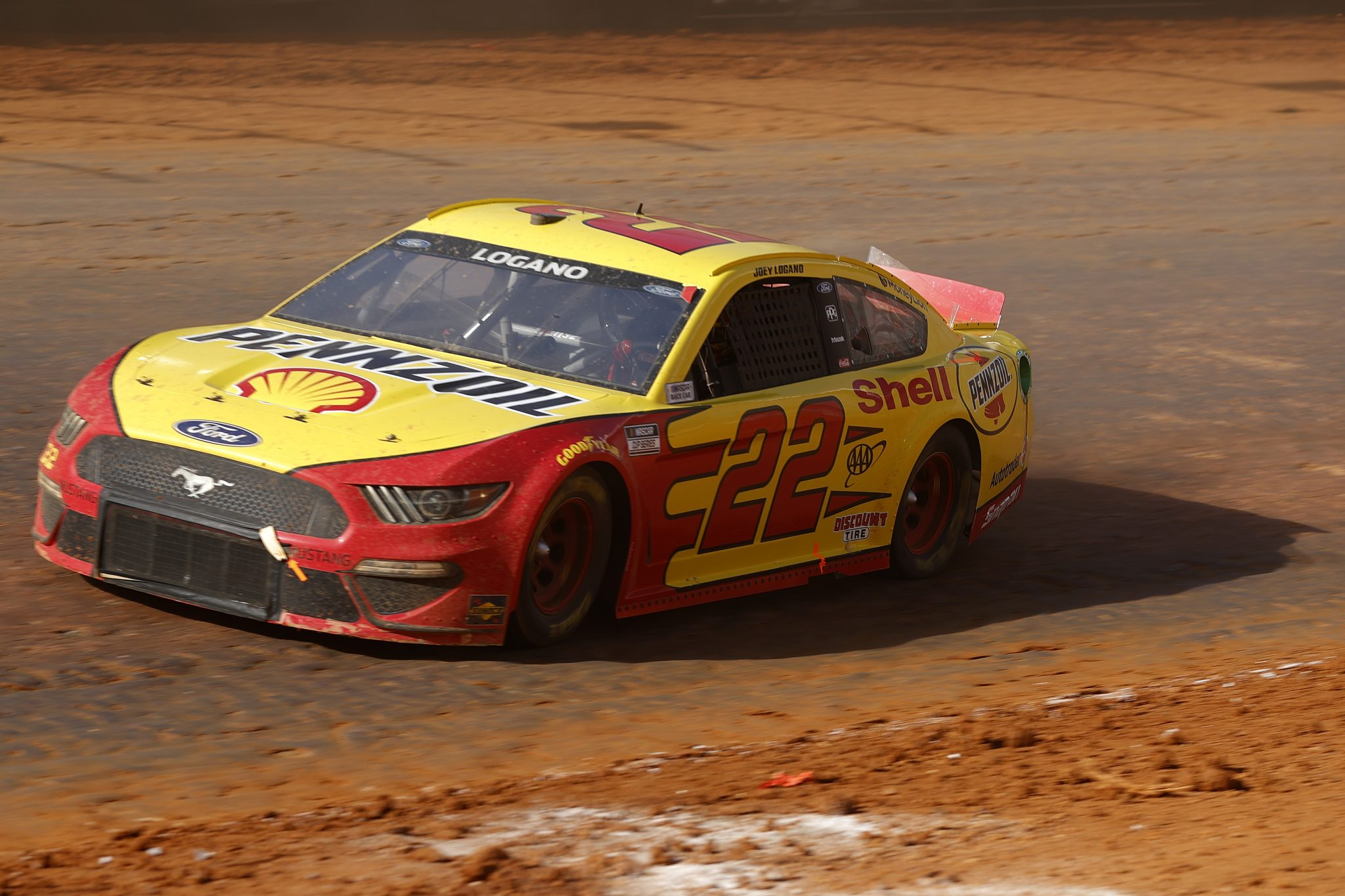 BRISTOL, TENNESSEE - MARCH 29: Joey Logano, driver of the #22 Shell Pennzoil Ford, drives during the NASCAR Cup Series Food City Dirt Race at Bristol Motor Speedway on March 29, 2021 in Bristol, Tennessee. (Photo by Chris Graythen/Getty Images) | Getty Images
