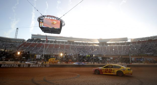 BRISTOL, TENNESSEE - MARCH 29: Joey Logano, driver of the #22 Shell Pennzoil Ford, celebrates with a burnout after winning  the NASCAR Cup Series Food City Dirt Race at Bristol Motor Speedway on March 29, 2021 in Bristol, Tennessee. (Photo by Jared C. Tilton/Getty Images) | Getty Images