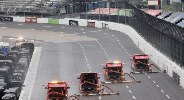 MARTINSVILLE, VIRGINIA - APRIL 10: The NASCAR Track Drying Team works to dry the track prior to the NASCAR Cup Series Blue-Emu Maximum Pain Relief 500 at Martinsville Speedway on April 10, 2021 in Martinsville, Virginia. (Photo by James Gilbert/Getty Images) | Getty Images