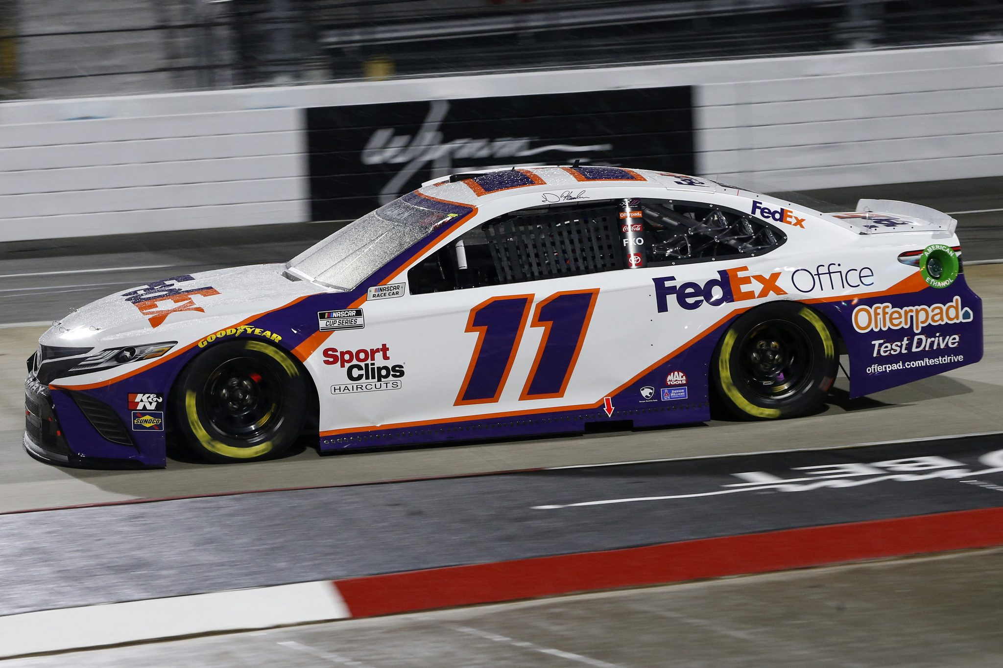 MARTINSVILLE, VIRGINIA - APRIL 10: Denny Hamlin, driver of the #11 FedEx Office Toyota, drives during the NASCAR Cup Series Blue-Emu Maximum Pain Relief 500 at Martinsville Speedway on April 10, 2021 in Martinsville, Virginia. (Photo by Brian Lawdermilk/Getty Images) | Getty Images