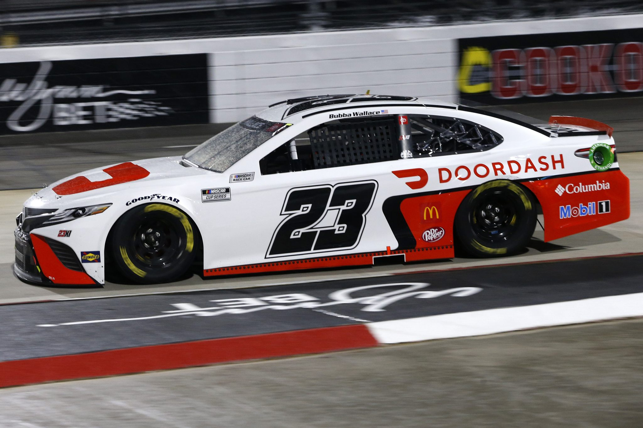 MARTINSVILLE, VIRGINIA - APRIL 10: Bubba Wallace, driver of the #23 DoorDash Toyota, drives during the NASCAR Cup Series Blue-Emu Maximum Pain Relief 500 at Martinsville Speedway on April 10, 2021 in Martinsville, Virginia. (Photo by Brian Lawdermilk/Getty Images) | Getty Images