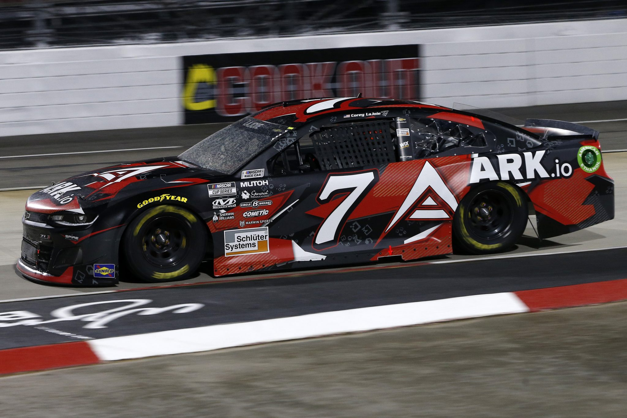 MARTINSVILLE, VIRGINIA - APRIL 10: Corey LaJoie, driver of the #7 ARK.io Chevrolet, drives during the NASCAR Cup Series Blue-Emu Maximum Pain Relief 500 at Martinsville Speedway on April 10, 2021 in Martinsville, Virginia. (Photo by Brian Lawdermilk/Getty Images) | Getty Images