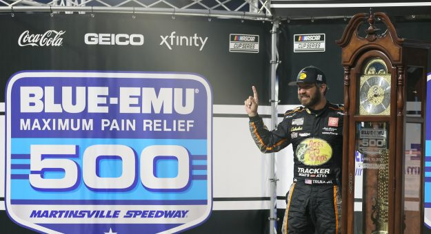 MARTINSVILLE, VIRGINIA - APRIL 11: Martin Truex Jr., driver of the #19 Bass Pro Toyota, celebrates in victory lane after winning  the NASCAR Cup Series Blue-Emu Maximum Pain Relief 500 at Martinsville Speedway on April 11, 2021 in Martinsville, Virginia. (Photo by James Gilbert/Getty Images) | Getty Images