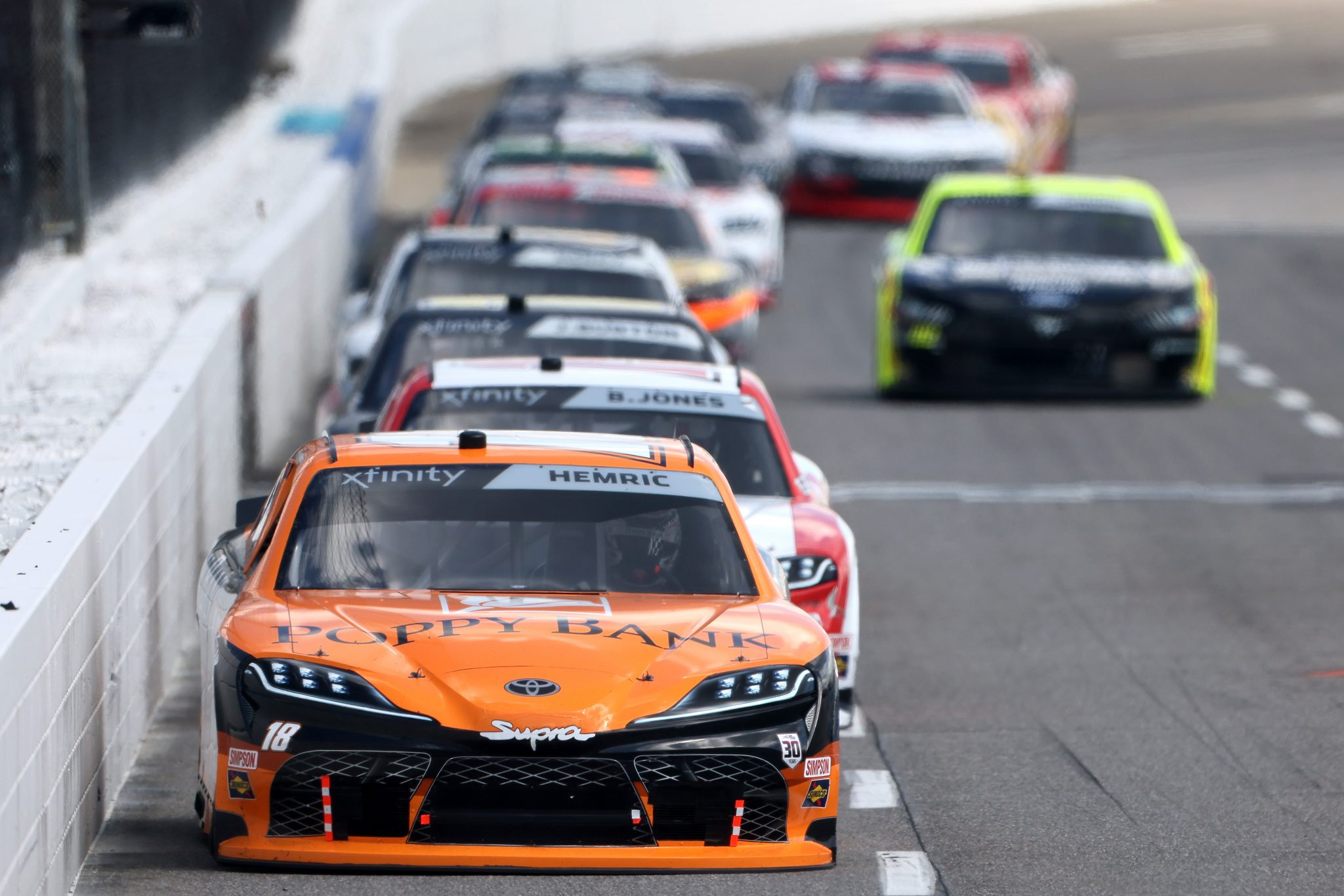 MARTINSVILLE, VIRGINIA - APRIL 11: Daniel Hemric, driver of the #18 Poppy Bank Toyota, leads the field during the NASCAR Xfinity Series Cook Out 250 at Martinsville Speedway on April 11, 2021 in Martinsville, Virginia. (Photo by James Gilbert/Getty Images) | Getty Images