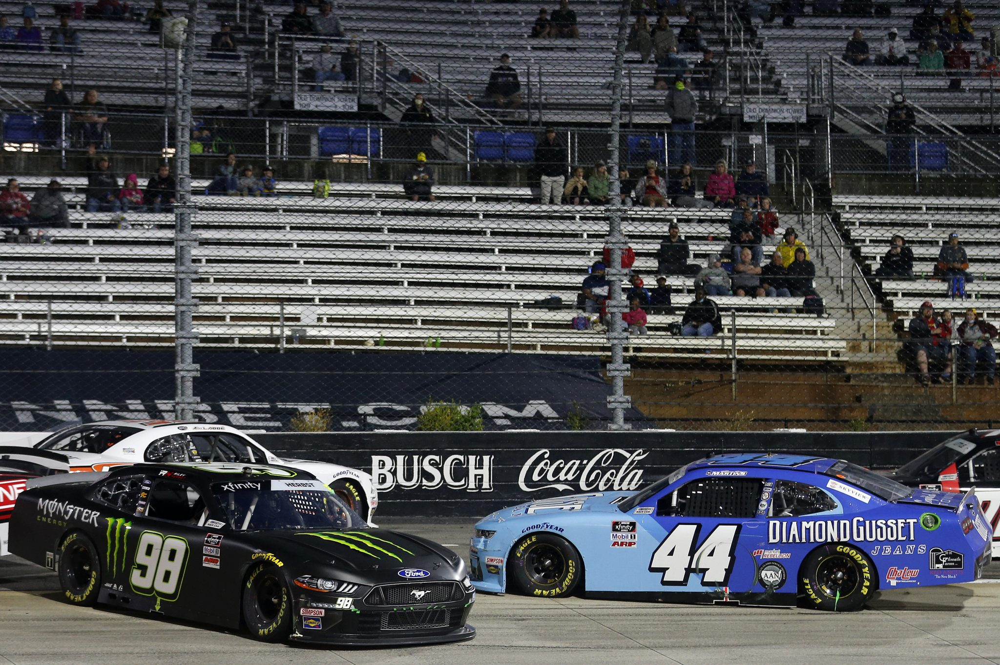 MARTINSVILLE, VIRGINIA - APRIL 09: Riley Herbst, driver of the #98 Monster Energy Ford, and Tommy Joe Martins, driver of the #44 Diamond Gusset Jeans Chevrolet, spin after an on-track incident during the NASCAR Xfinity Series Cook Out 250 at Martinsville Speedway on April 09, 2021 in Martinsville, Virginia. (Photo by Brian Lawdermilk/Getty Images) | Getty Images