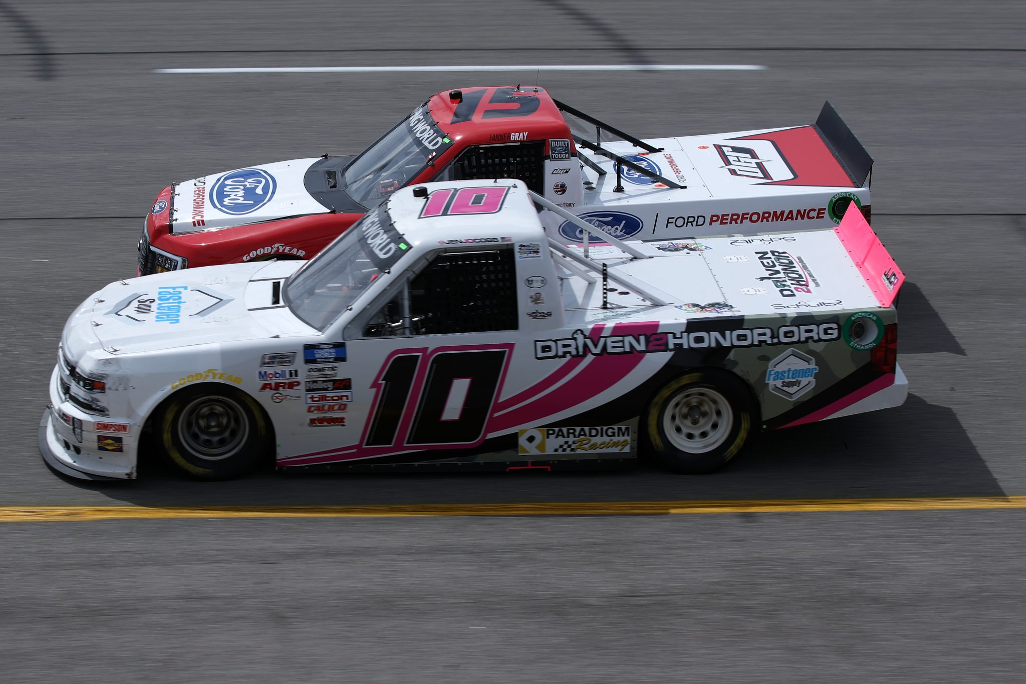 RICHMOND, VIRGINIA - APRIL 17: Jennifer Jo Cobb, driver of the #10 Fastener Supply Company Chevrolet, and Tanner Gray, driver of the #15 Ford Performance Ford, race during the NASCAR Camping World Truck Series ToyotaCare 250 at Richmond Raceway on April 17, 2021 in Richmond, Virginia. (Photo by Sean Gardner/Getty Images)   Getty Images