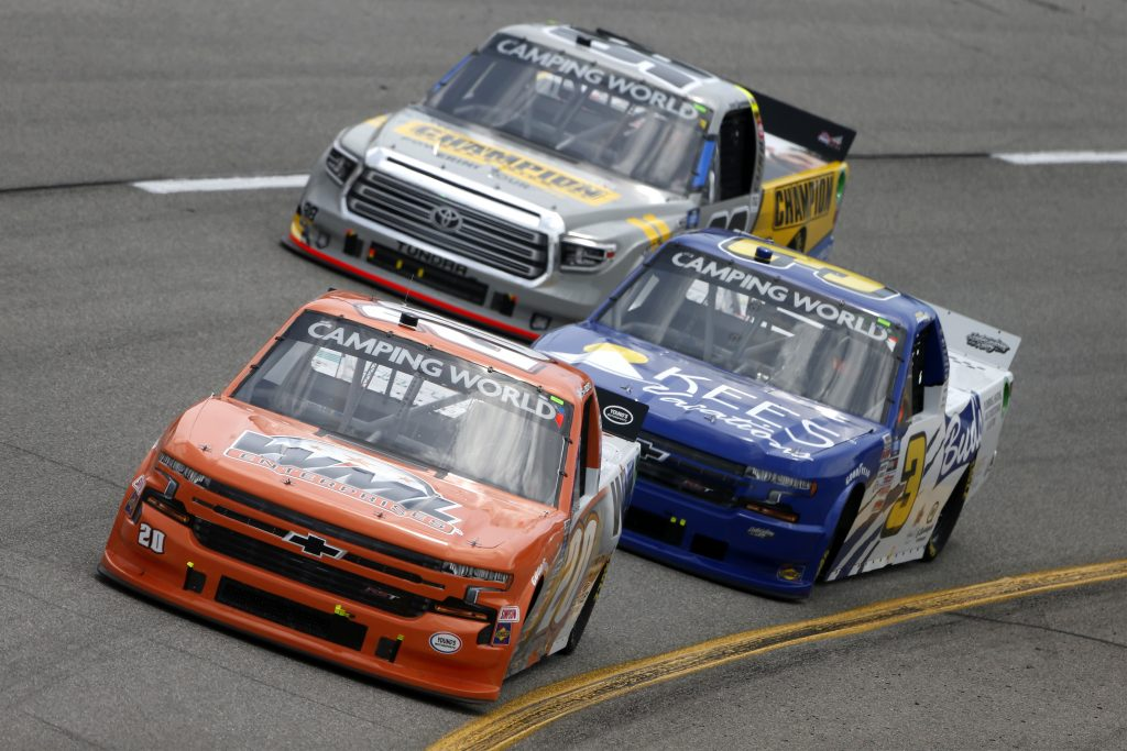 RICHMOND, VIRGINIA - APRIL 17: Spencer Boyd, driver of the #20 WML Enterprises Chevrolet, and Howie Disavino III, driver of the #3 KEES Vacations/Bud's Chevrolet, race during the NASCAR Camping World Truck Series ToyotaCare 250 at Richmond Raceway on April 17, 2021 in Richmond, Virginia. (Photo by Brian Lawdermilk/Getty Images) | Getty Images