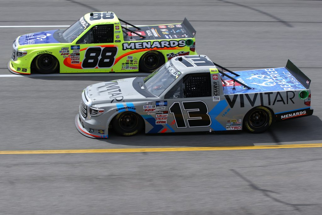 RICHMOND, VIRGINIA - APRIL 17: Johnny Sauter, driver of the #13 Vivitar Toyota, and Matt Crafton, driver of the #88 Great Lakes Flooring/Menards Toyota, race during the NASCAR Camping World Truck Series ToyotaCare 250 at Richmond Raceway on April 17, 2021 in Richmond, Virginia. (Photo by Sean Gardner/Getty Images) | Getty Images