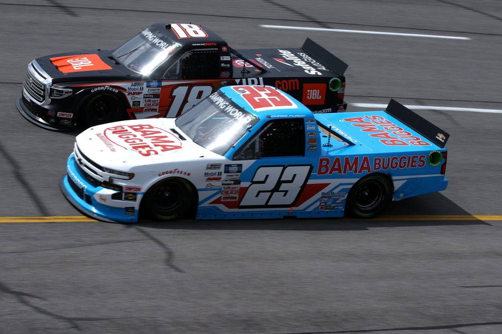 RICHMOND, VIRGINIA - APRIL 17: Chase Purdy, driver of the #23 BamaBuggies.com Chevrolet, and Chandler Smith, driver of the #18 JBL Toyota, race during the NASCAR Camping World Truck Series ToyotaCare 250 at Richmond Raceway on April 17, 2021 in Richmond, Virginia. (Photo by Sean Gardner/Getty Images) | Getty Images