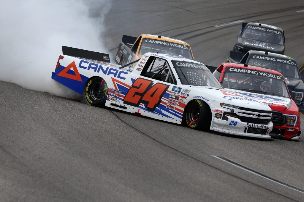 RICHMOND, VIRGINIA - APRIL 17: Raphael Lessard, driver of the #24 CANAC Chevrolet, spins after an on-track on-track incident with Tanner Gray, driver of the #15 Ford Performance Ford, during the NASCAR Camping World Truck Series ToyotaCare 250 at Richmond Raceway on April 17, 2021 in Richmond, Virginia. (Photo by Brian Lawdermilk/Getty Images) | Getty Images