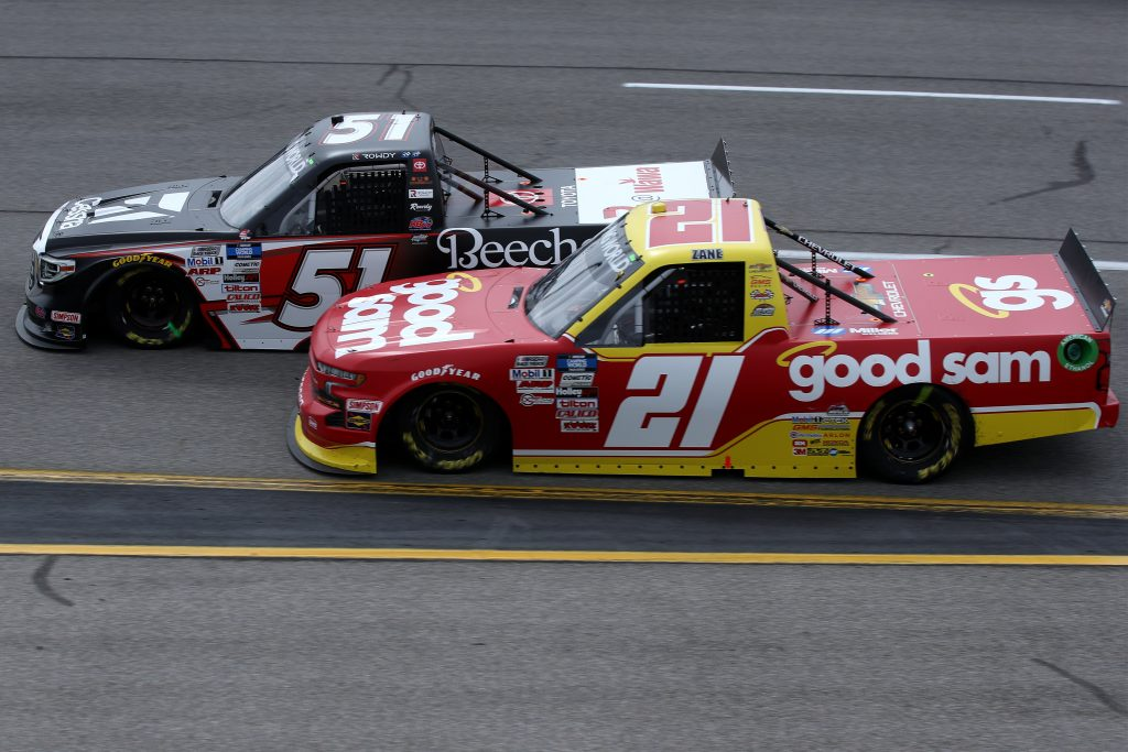 RICHMOND, VIRGINIA - APRIL 17: Zane Smith, driver of the #21 Chevrolet, and Kyle Busch, driver of the #51 Cessna Toyota, race during the NASCAR Camping World Truck Series ToyotaCare 250 at Richmond Raceway on April 17, 2021 in Richmond, Virginia. (Photo by Sean Gardner/Getty Images) | Getty Images