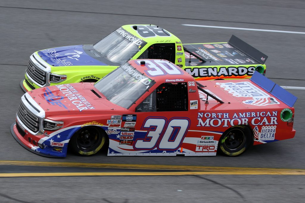 RICHMOND, VIRGINIA - APRIL 17: Danny Bohn, driver of the #30 North American Motor Car Toyota, and Matt Crafton, driver of the #88 Great Lakes Flooring/Menards Toyota, race during the NASCAR Camping World Truck Series ToyotaCare 250 at Richmond Raceway on April 17, 2021 in Richmond, Virginia. (Photo by Sean Gardner/Getty Images) | Getty Images