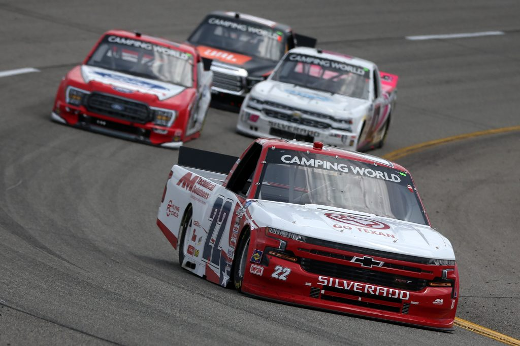 RICHMOND, VIRGINIA - APRIL 17: Austin Wayne Self, driver of the #22 GO TEXAN/AM Technical Solutions Chevrolet, drives during the NASCAR Camping World Truck Series ToyotaCare 250 at Richmond Raceway on April 17, 2021 in Richmond, Virginia. (Photo by Brian Lawdermilk/Getty Images) | Getty Images