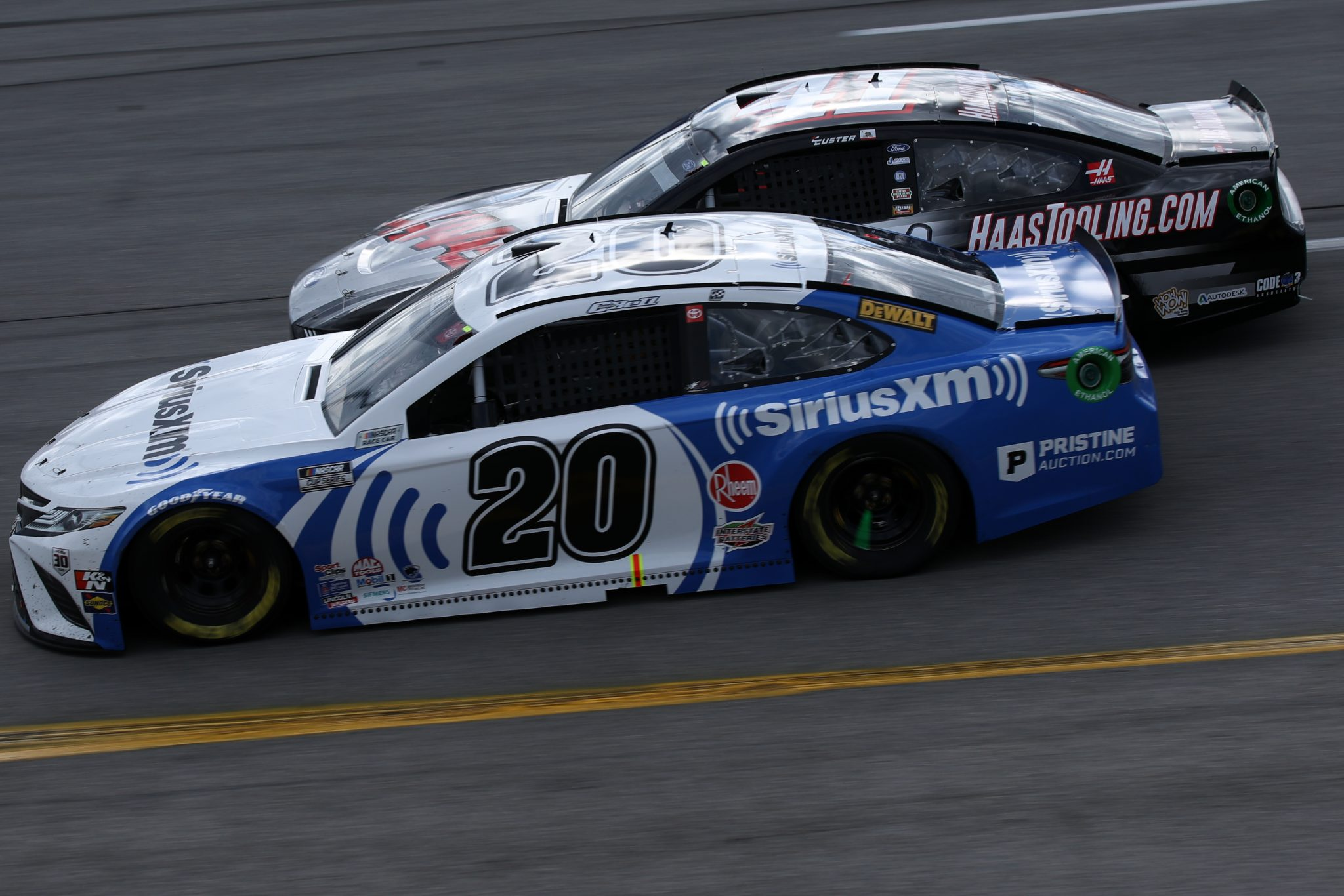 RICHMOND, VIRGINIA - APRIL 18: Christopher Bell, driver of the #20 Sirius XM Toyota, and Cole Custer, driver of the #41 HaasTooling.com Ford, race during the NASCAR Cup Series Toyota Owners 400 at Richmond Raceway on April 18, 2021 in Richmond, Virginia. (Photo by Sean Gardner/Getty Images) | Getty Images