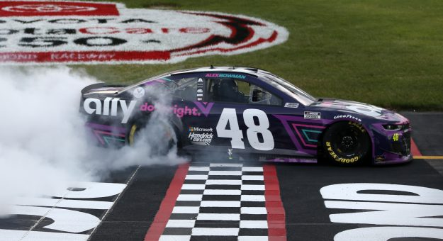 RICHMOND, VIRGINIA - APRIL 18: Alex Bowman, driver of the #48 Ally Chevrolet, celebrates with a burnout after winning the NASCAR Cup Series Toyota Owners 400 at Richmond Raceway on April 18, 2021 in Richmond, Virginia. (Photo by Brian Lawdermilk/Getty Images) | Getty Images
