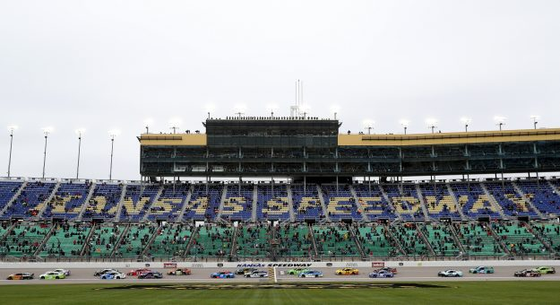 KANSAS CITY, KANSAS - OCTOBER 18: Tyler Reddick, driver of the #8 Caterpillar Chevrolet, leads a pack of cars during the NASCAR Cup Series  Hollywood Casino 400 at Kansas Speedway on October 18, 2020 in Kansas City, Kansas. (Photo by Chris Graythen/Getty Images) | Getty Images