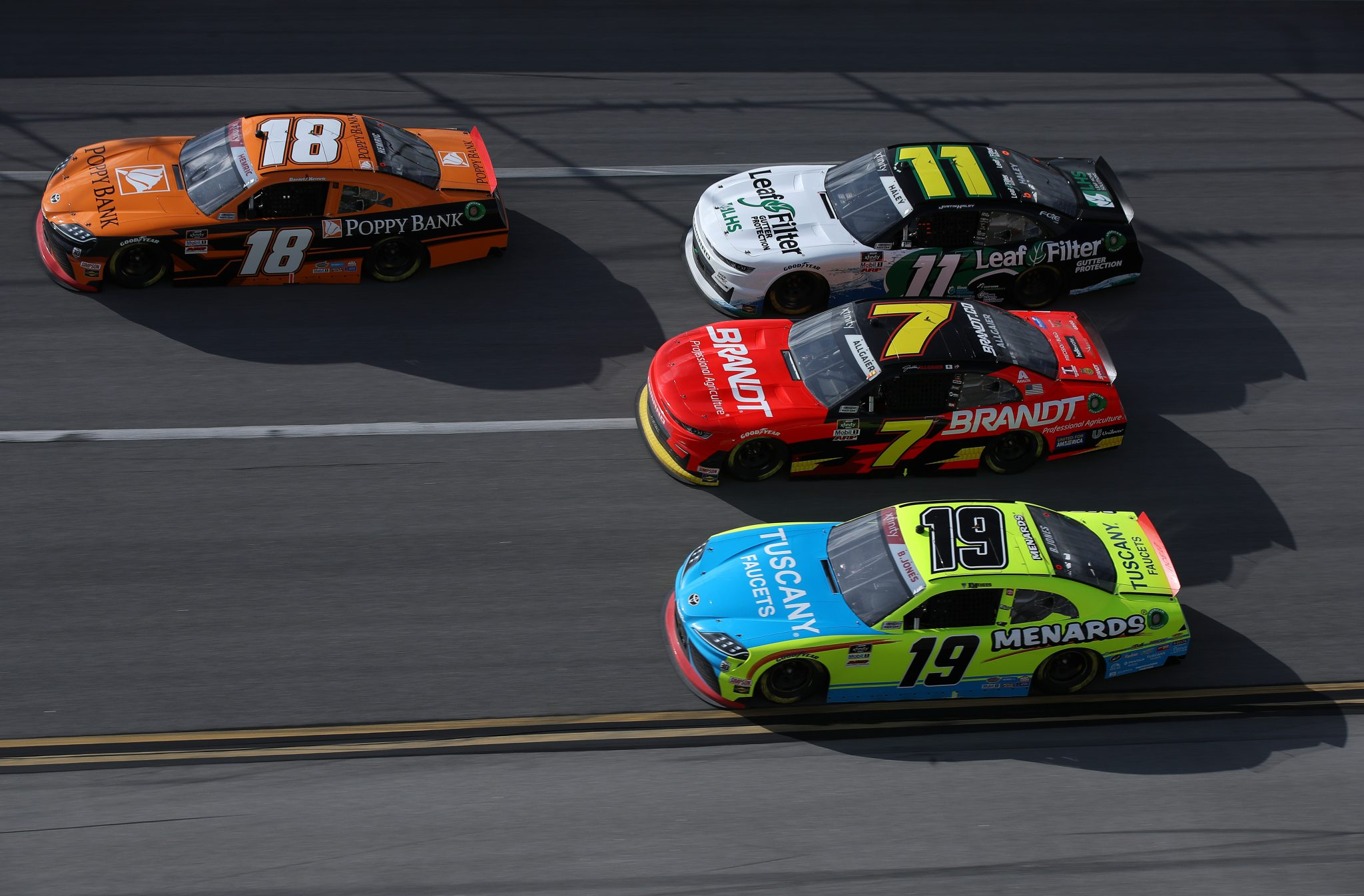 TALLADEGA, ALABAMA - APRIL 24: Daniel Hemric, driver of the #18 Poppy Bank Toyota, Brandon Jones, driver of the #19 Menards/Tuscany Faucets Toyota, Justin Allgaier, driver of the #7 BRANDT Chevrolet, and Justin Haley, driver of the #11 LeafFilter Gutter Protection Chevrolet, race during the NASCAR Xfinity Series Ag-Pro 300 at Talladega Superspeedway on April 24, 2021 in Talladega, Alabama. (Photo by Sean Gardner/Getty Images)   Getty Images