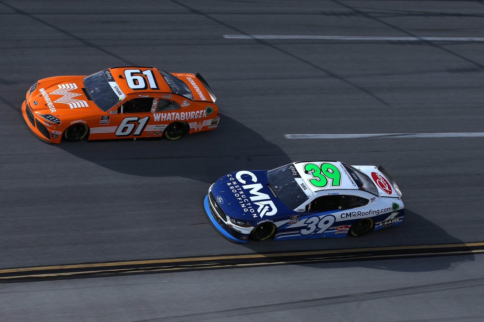 TALLADEGA, ALABAMA - APRIL 24: Ryan Sieg, driver of the #39 CMR Construction and Roofing Ford, and David Starr, driver of the #61 Whataburger Toyota, race during the NASCAR Xfinity Series Ag-Pro 300 at Talladega Superspeedway on April 24, 2021 in Talladega, Alabama. (Photo by Sean Gardner/Getty Images) | Getty Images