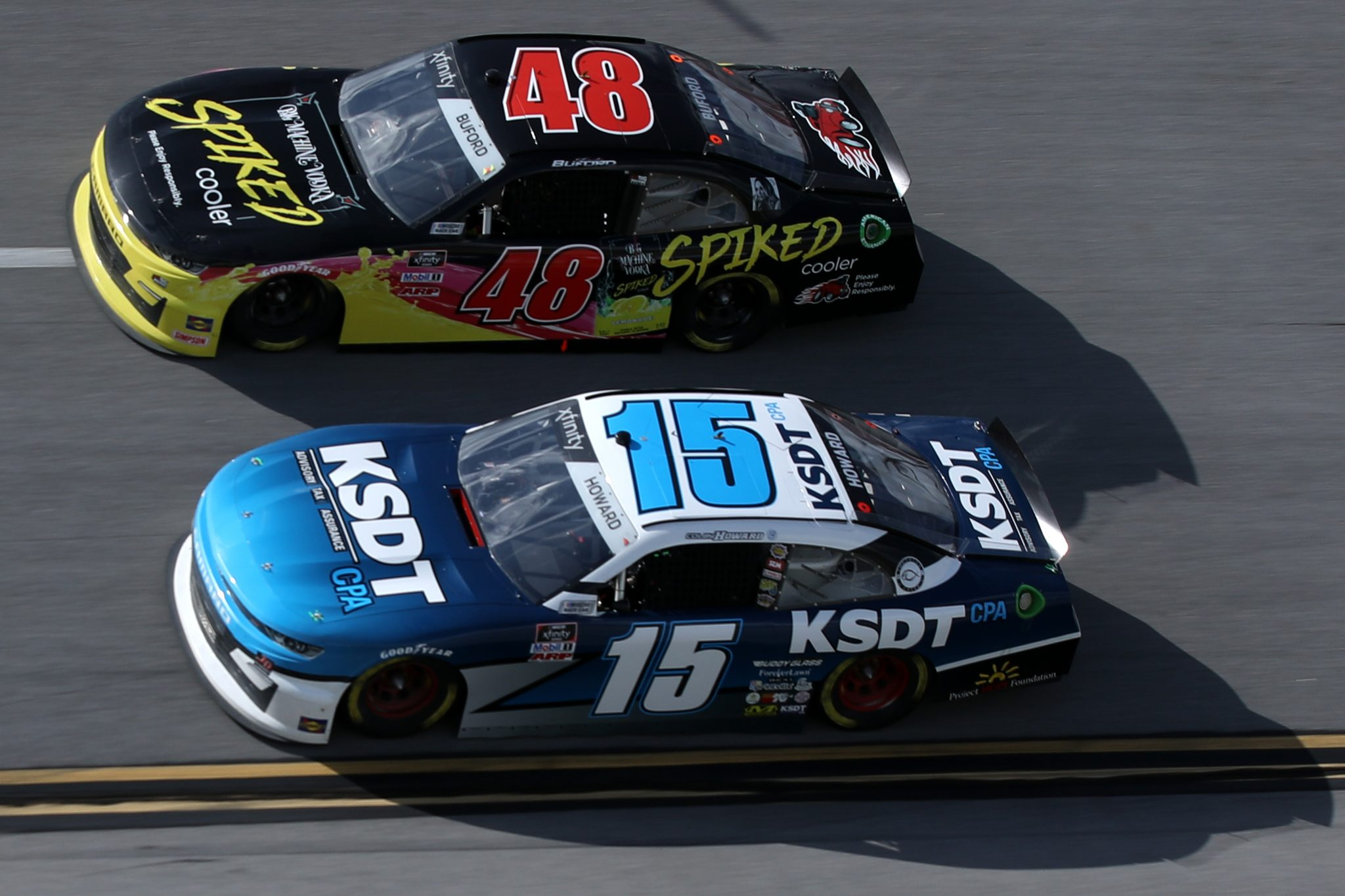 TALLADEGA, ALABAMA - APRIL 24: Colby Howard, driver of the #15 KSDT CPA Chevrolet, and Jade Buford, driver of the #48 Big Machine Spiked Coolers Chevrolet, race during the NASCAR Xfinity Series Ag-Pro 300 at Talladega Superspeedway on April 24, 2021 in Talladega, Alabama. (Photo by Sean Gardner/Getty Images) | Getty Images