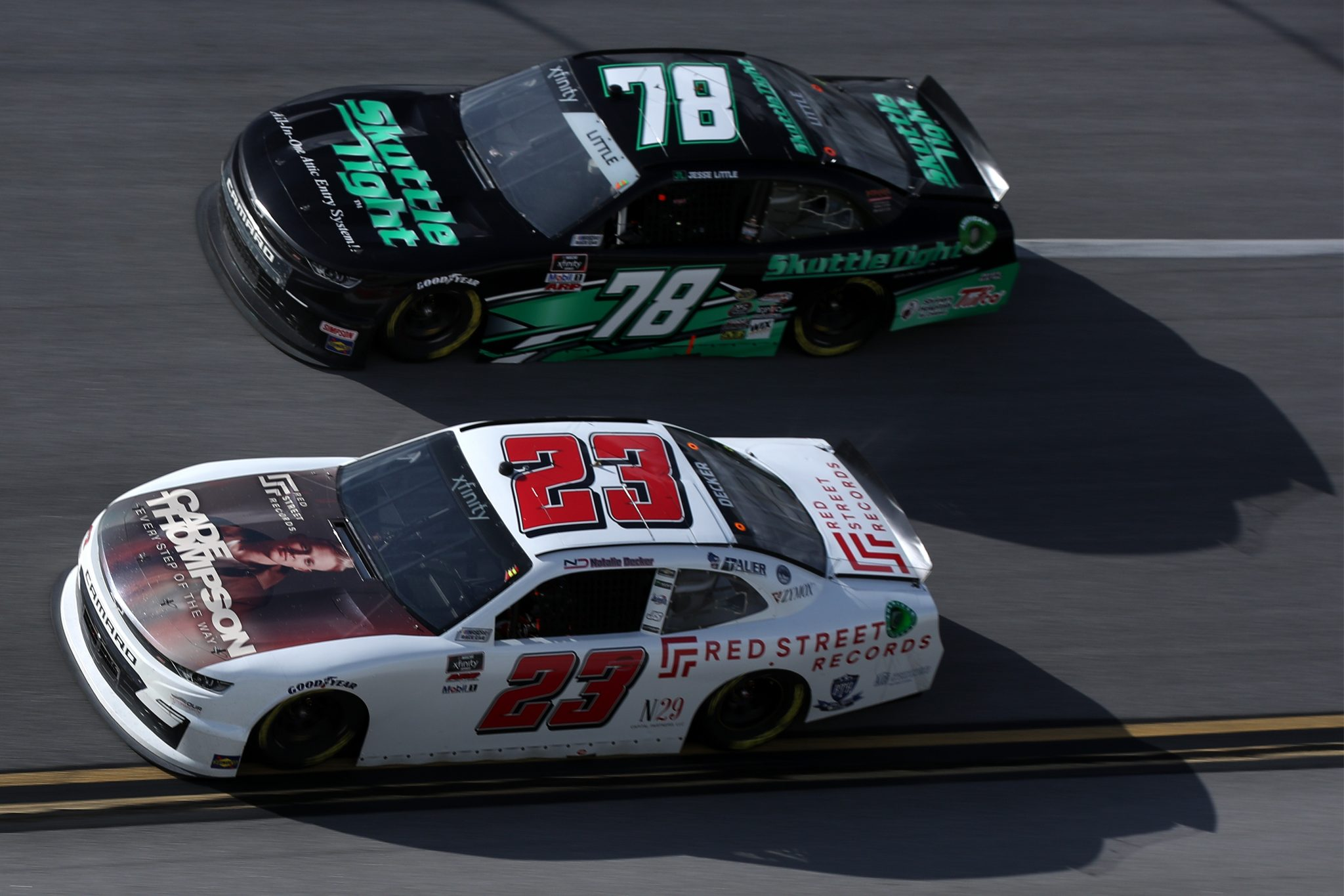 TALLADEGA, ALABAMA - APRIL 24: Natalie Decker, driver of the #23 Red Street Records Chevrolet, and Jesse Little, driver of the #78 Skuttle Tight Chevrolet, race during the NASCAR Xfinity Series Ag-Pro 300 at Talladega Superspeedway on April 24, 2021 in Talladega, Alabama. (Photo by Sean Gardner/Getty Images) | Getty Images
