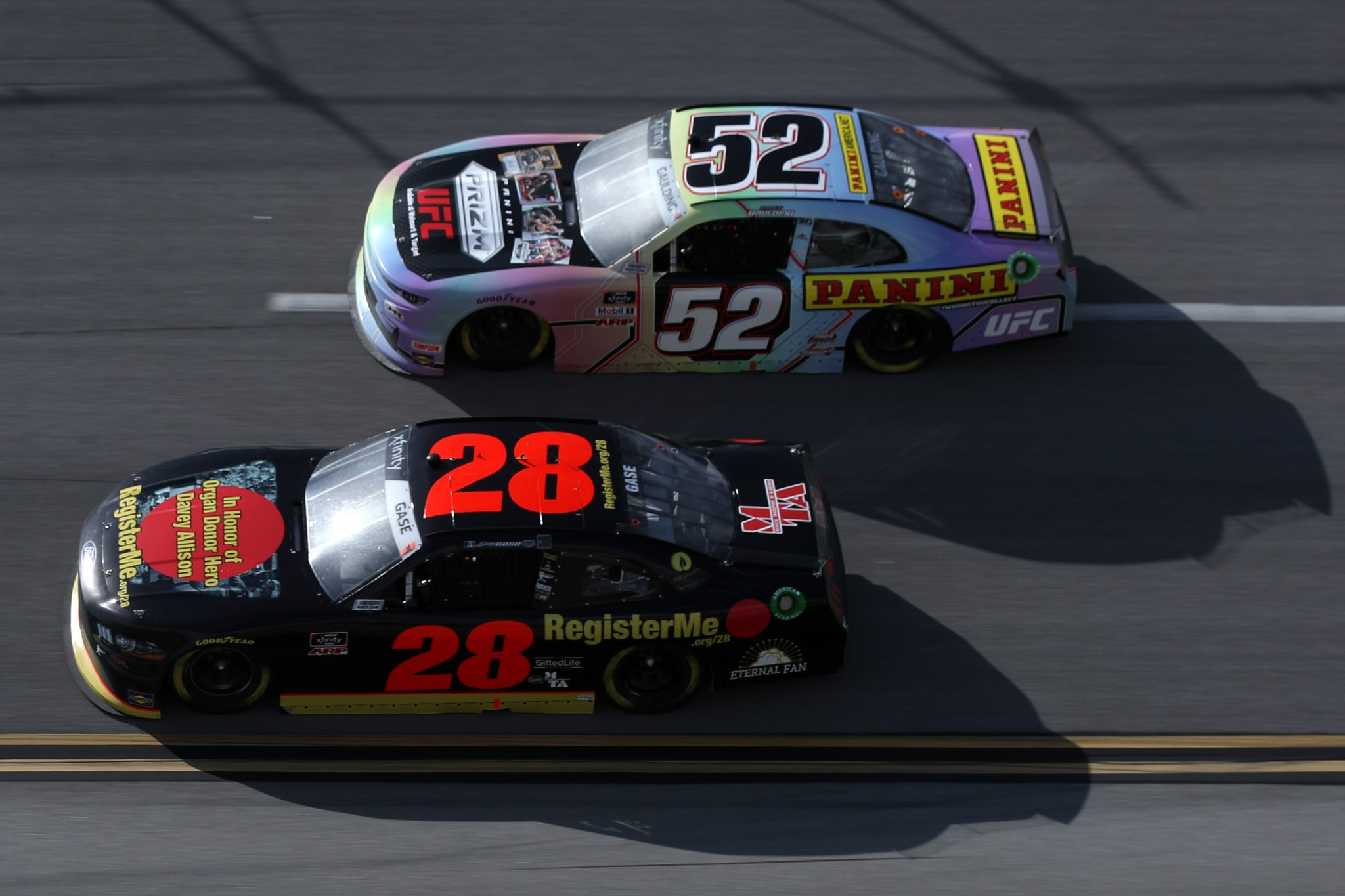 TALLADEGA, ALABAMA - APRIL 24: Gray Gaulding, driver of the #52 Panini America Chevrolet, and Joey Gase, driver of the #28 Register Me Chevrolet, race during the NASCAR Xfinity Series Ag-Pro 300 at Talladega Superspeedway on April 24, 2021 in Talladega, Alabama. (Photo by Sean Gardner/Getty Images)   Getty Images
