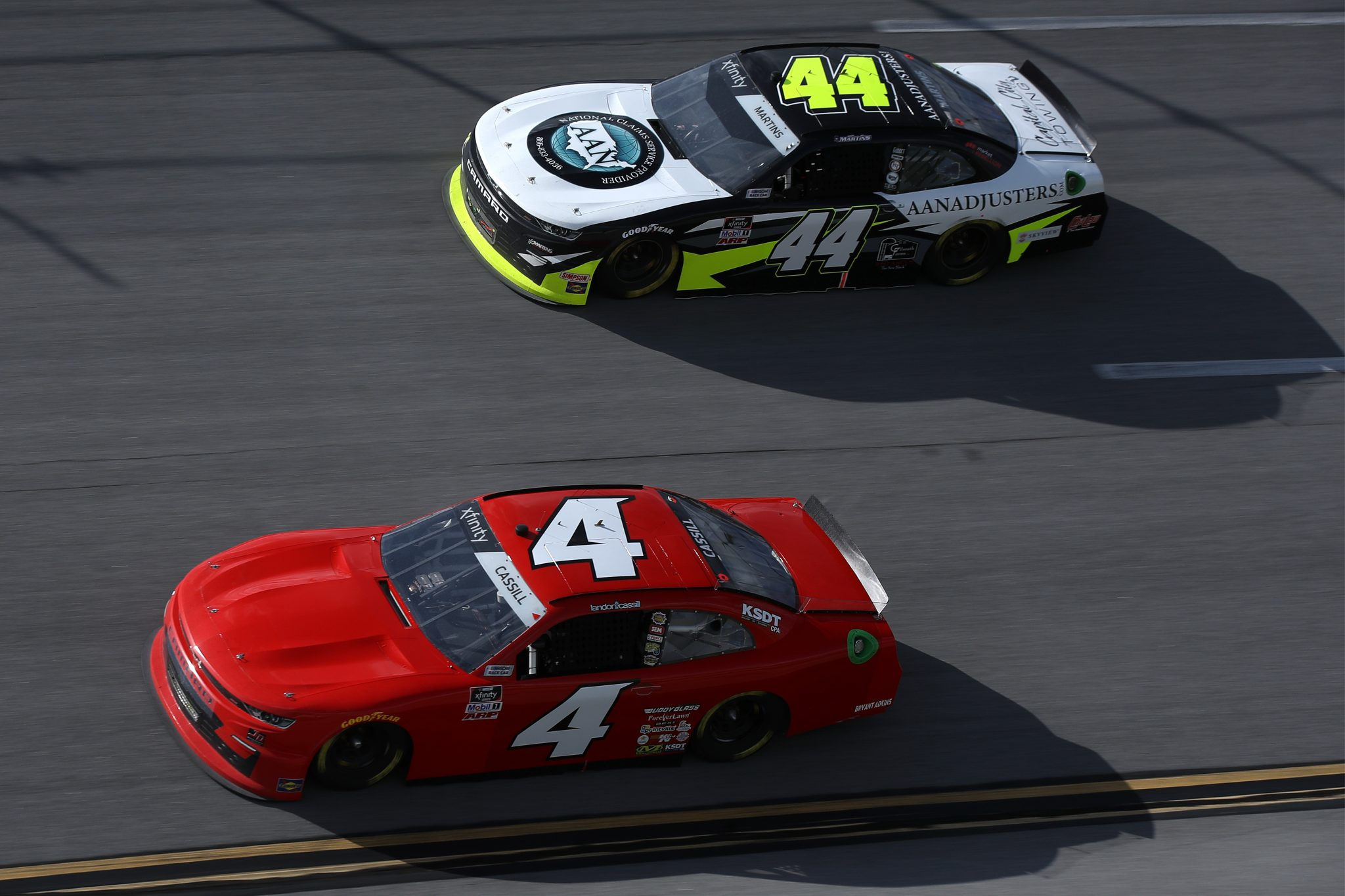 TALLADEGA, ALABAMA - APRIL 24: Landon Cassill, driver of the #4 TeamJDMotorsports.com Chevrolet, and Tommy Joe Martins, driver of the #44 AAN Adjusters Chevrolet, race during the NASCAR Xfinity Series Ag-Pro 300 at Talladega Superspeedway on April 24, 2021 in Talladega, Alabama. (Photo by Sean Gardner/Getty Images)   Getty Images