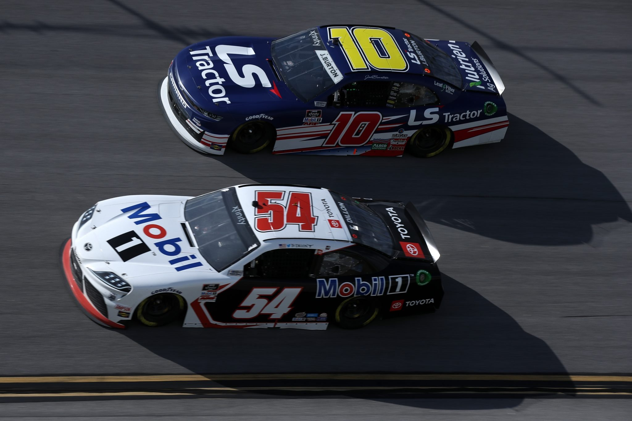 TALLADEGA, ALABAMA - APRIL 24: Ty Dillon, driver of the #54 Mobil 1 Toyota, and Jeb Burton, driver of the #10 LS Tractors Chevrolet, race during the NASCAR Xfinity Series Ag-Pro 300 at Talladega Superspeedway on April 24, 2021 in Talladega, Alabama. (Photo by Sean Gardner/Getty Images) | Getty Images