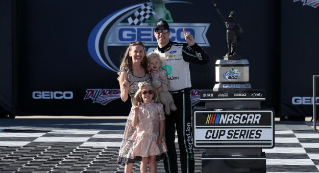TALLADEGA, ALABAMA - APRIL 25: Brad Keselowski, driver of the #2 MoneyLion Ford, celebrates with his wife Paige and daughters Autumn and Scarlett in victory lane after winning the NASCAR Cup Series  GEICO 500 at Talladega Superspeedway on April 25, 2021 in Talladega, Alabama. (Photo by Sean Gardner/Getty Images)   Getty Images