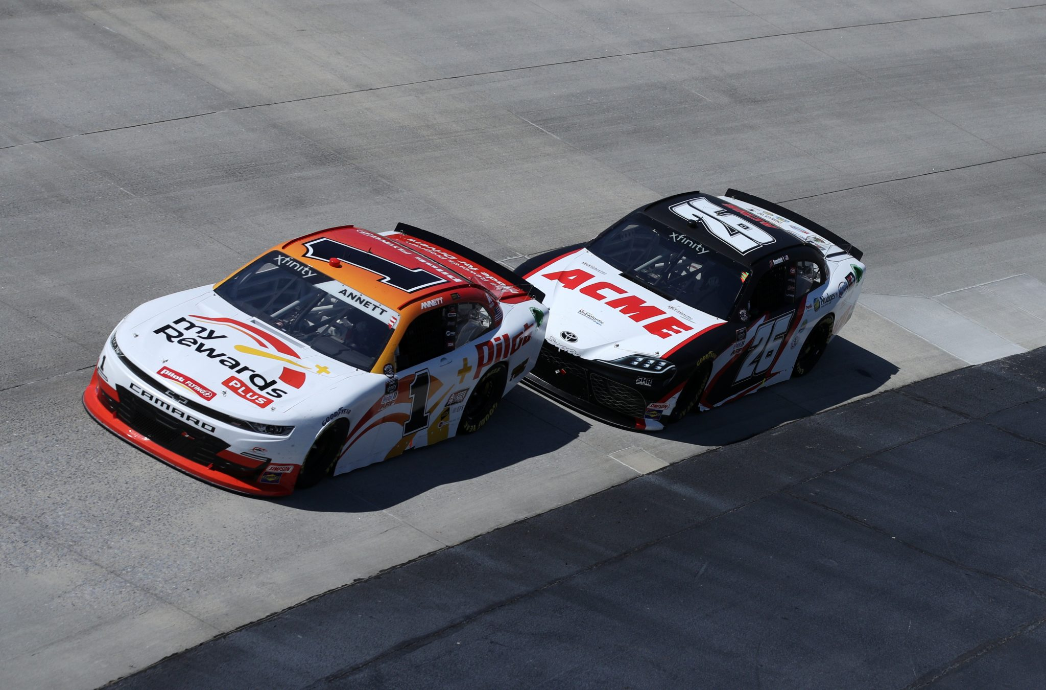 DOVER, DELAWARE - MAY 15: Michael Annett, driver of the #1 Pilot Flying J myRewards Plus Chevrolet, and John H. Nemechek, driver of the #26 ACME Toyota, race during the NASCAR Xfinity Series Drydene 200 race at Dover International Speedway on May 15, 2021 in Dover, Delaware. (Photo by Sean Gardner/Getty Images) | Getty Images