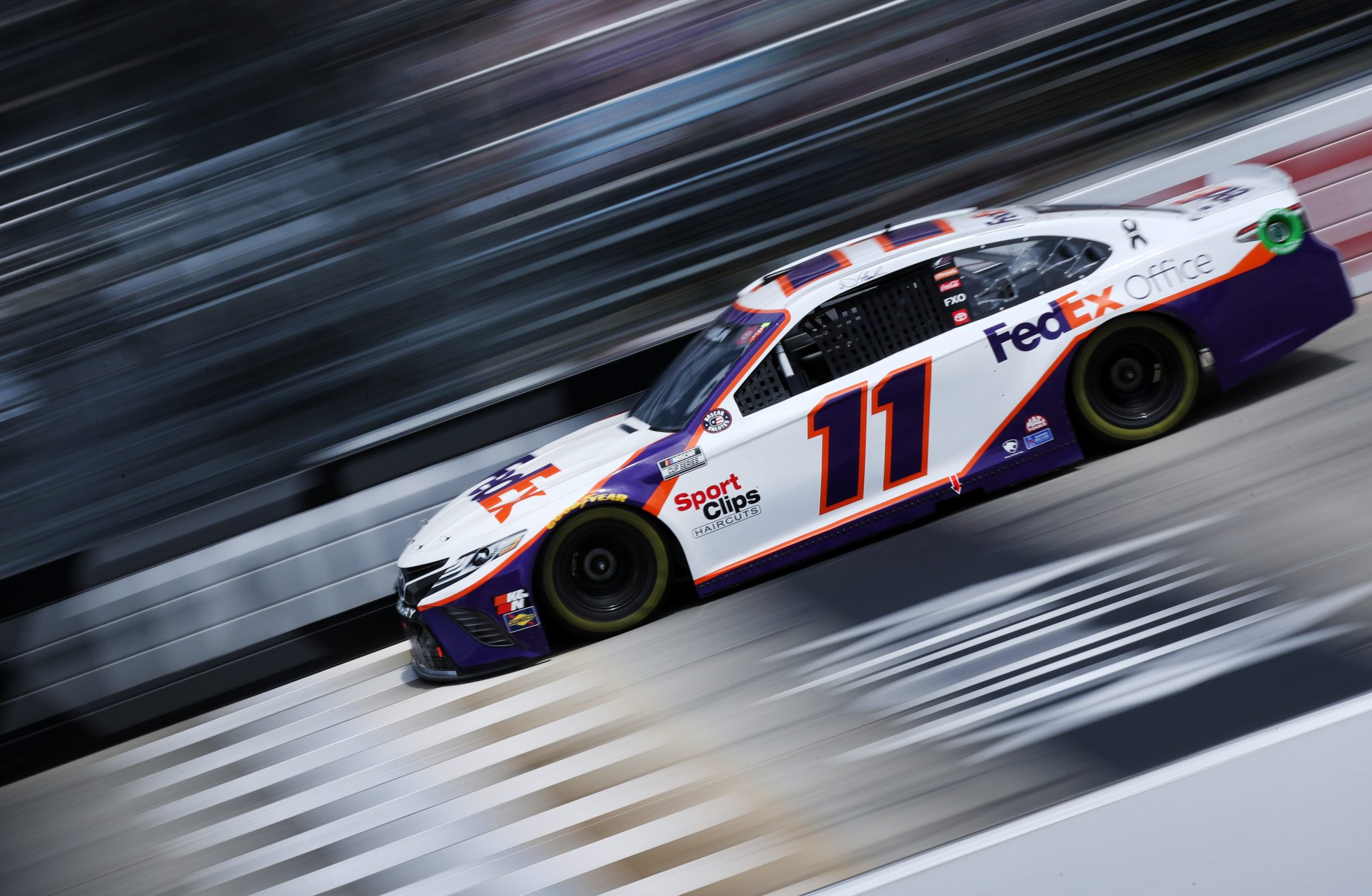 DOVER, DELAWARE - MAY 16: Denny Hamlin, driver of the #11 FedEx Office Toyota, races during the NASCAR Cup Series Drydene 400 at Dover International Speedway on May 16, 2021 in Dover, Delaware. (Photo by Sean Gardner/Getty Images) | Getty Images