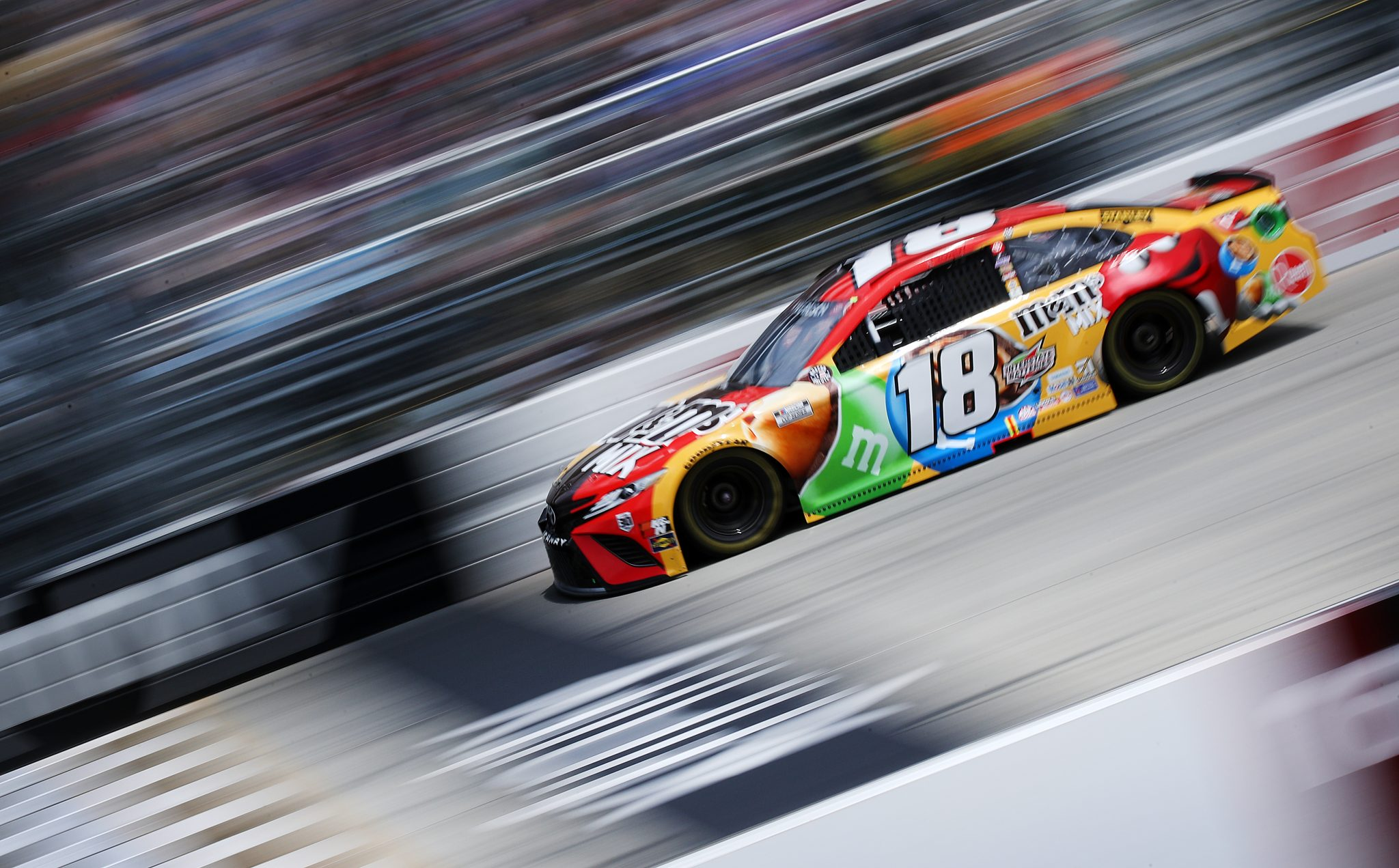 DOVER, DELAWARE - MAY 16: Kyle Busch, driver of the #18 M&M's Mix Toyota, races during the NASCAR Cup Series Drydene 400 at Dover International Speedway on May 16, 2021 in Dover, Delaware. (Photo by Sean Gardner/Getty Images) | Getty Images