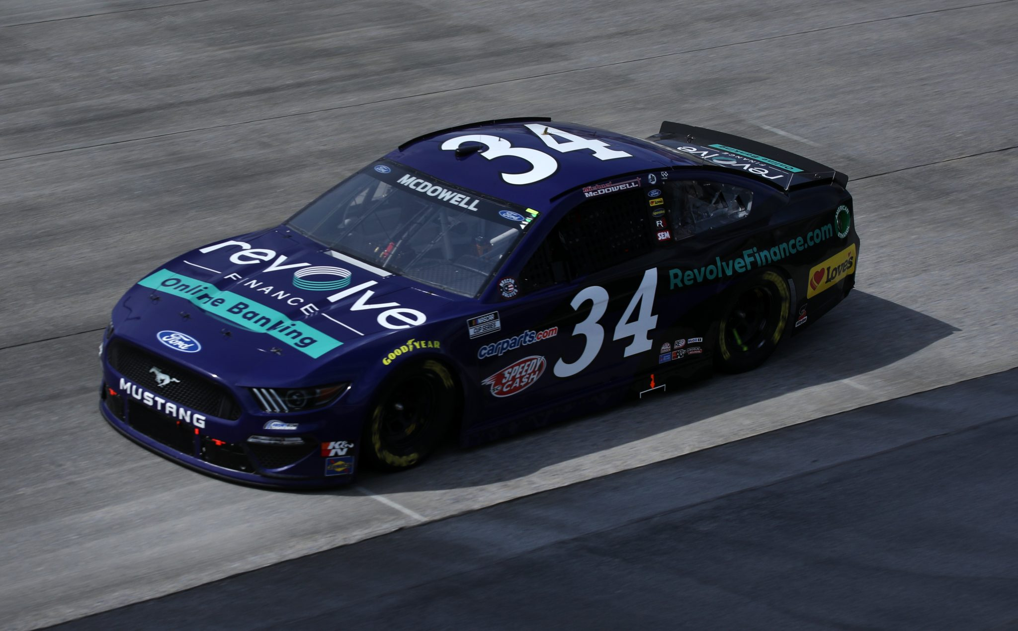 DOVER, DELAWARE - MAY 16: Michael McDowell, driver of the #34 Revolve Finance Ford, races during the NASCAR Cup Series Drydene 400 at Dover International Speedway on May 16, 2021 in Dover, Delaware. (Photo by Sean Gardner/Getty Images) | Getty Images