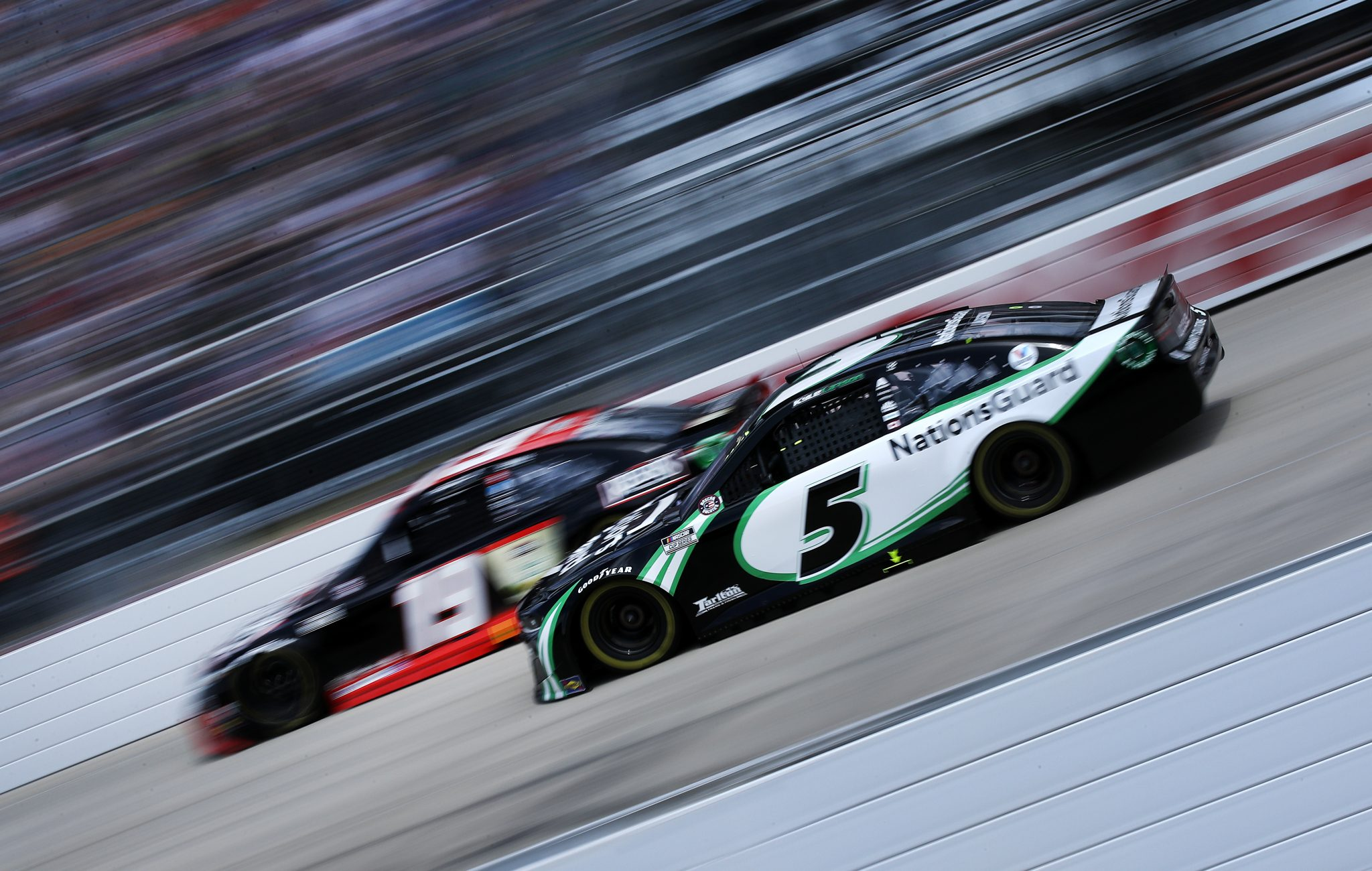 DOVER, DELAWARE - MAY 16: Kyle Larson, driver of the #5 NationsGuard Chevrolet, and Martin Truex Jr., driver of the #19 Reser's Fine Foods Toyota, race during the NASCAR Cup Series Drydene 400 at Dover International Speedway on May 16, 2021 in Dover, Delaware. (Photo by Sean Gardner/Getty Images) | Getty Images