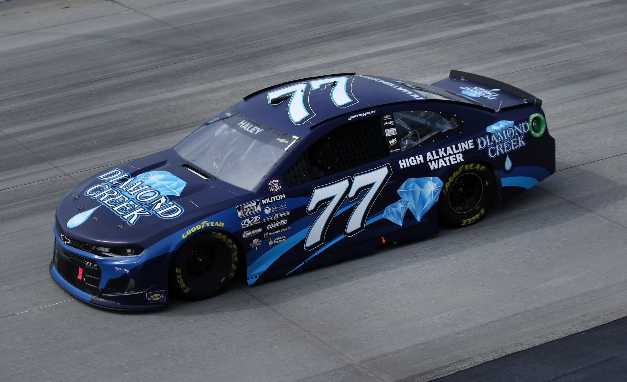 DOVER, DELAWARE - MAY 16: Justin Haley, driver of the #77 Diamond Creek Water Chevrolet, races during the NASCAR Cup Series Drydene 400 at Dover International Speedway on May 16, 2021 in Dover, Delaware. (Photo by Sean Gardner/Getty Images) | Getty Images