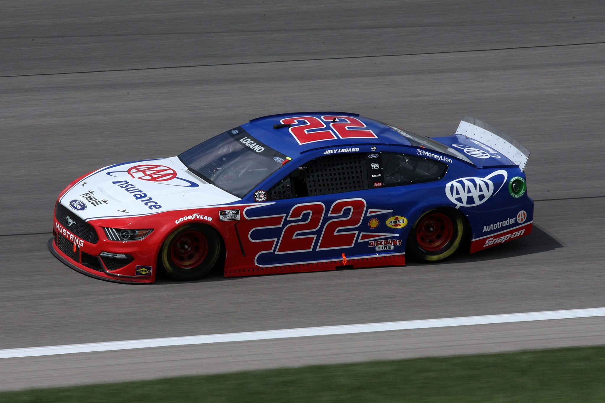 KANSAS CITY, KANSAS - MAY 02: Joey Logano, driver of the #22 AAA Insurance Ford, drives during the NASCAR Cup Series Buschy McBusch Race 400 at Kansas Speedway on May 02, 2021 in Kansas City, Kansas. (Photo by Sean Gardner/Getty Images) | Getty Images