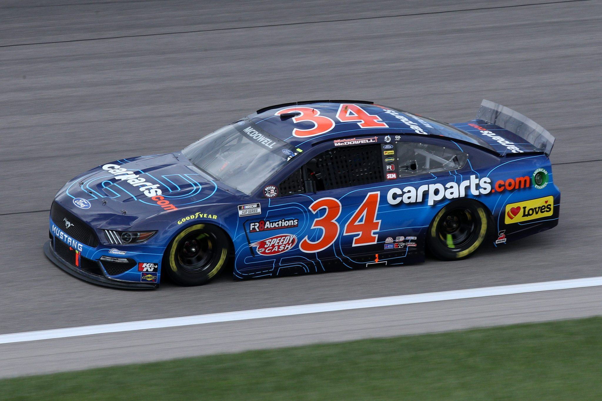KANSAS CITY, KANSAS - MAY 02: Michael McDowell, driver of the #34 CarParts.com Ford, drives during the NASCAR Cup Series Buschy McBusch Race 400 at Kansas Speedway on May 02, 2021 in Kansas City, Kansas. (Photo by Sean Gardner/Getty Images) | Getty Images