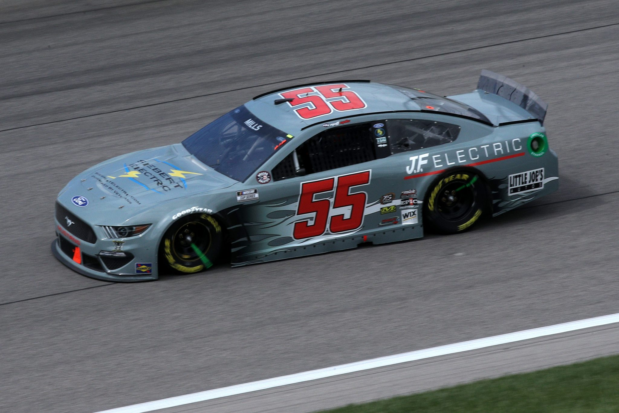 KANSAS CITY, KANSAS - MAY 02: Matt Mills, driver of the #55 Siebert Electric/J.F. Electric Ford, drives during the NASCAR Cup Series Buschy McBusch Race 400 at Kansas Speedway on May 02, 2021 in Kansas City, Kansas. (Photo by Sean Gardner/Getty Images) | Getty Images