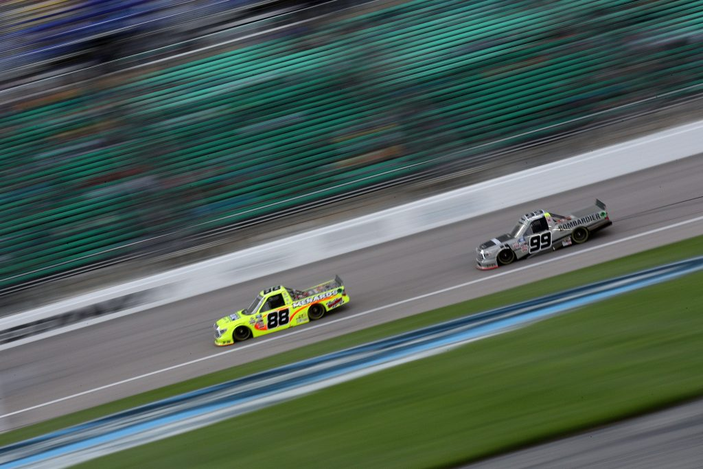 KANSAS CITY, KANSAS - MAY 01: Ben Rhodes, driver of the #99 Bombardier LearJet 75 Toyota, and Matt Crafton, driver of the #88 Ideal Door/Menards Toyota, race during the NASCAR Camping World Truck Series Wise Power 200 at Kansas Speedway on May 01, 2021 in Kansas City, Kansas. (Photo by Sean Gardner/Getty Images) | Getty Images