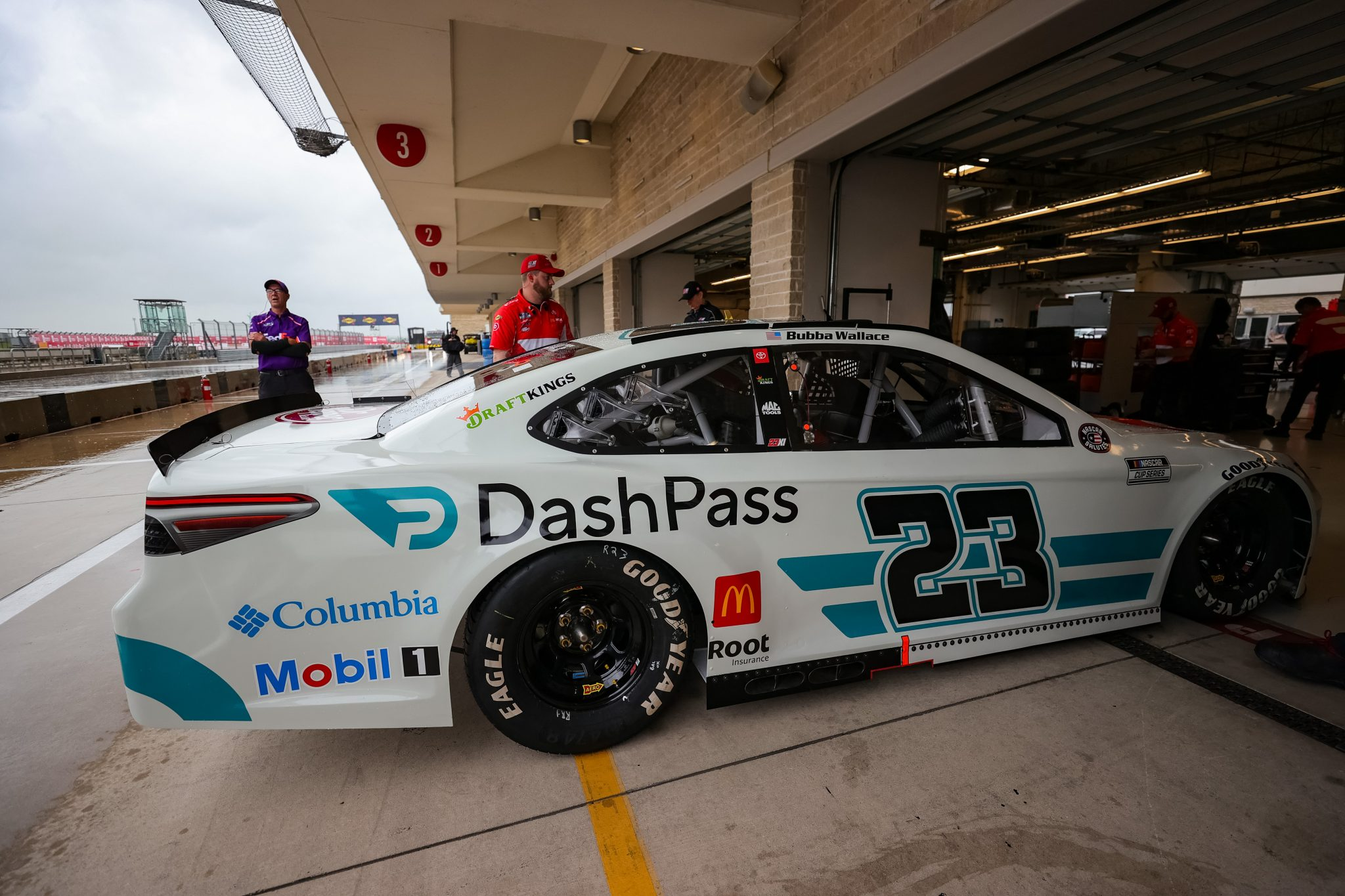 AUSTIN, TEXAS - MAY 22: Crewmembers push the #23 DoorDash Toyota, driven by Bubba Wallace into the garage area during practice for the NASCAR Cup Series EchoPark Texas Grand at Circuit of The Americas on May 22, 2021 in Austin, Texas. (Photo by Carmen Mandato/Getty Images)   Getty Images