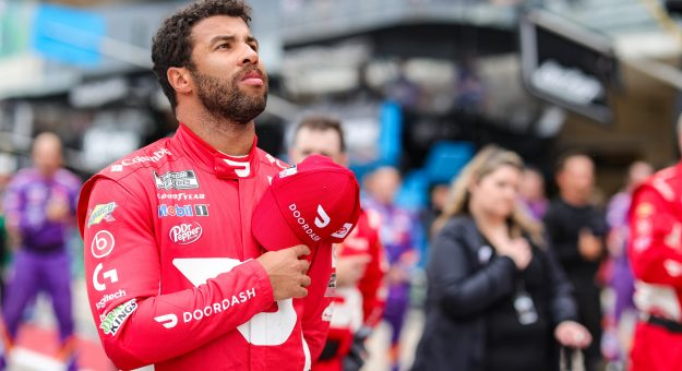 AUSTIN, TEXAS - MAY 23: Bubba Wallace, driver of the #23 DoorDash Toyota, stands during the national anthem prior to the NASCAR Cup Series EchoPark Texas Grand Prix at Circuit of The Americas on May 23, 2021 in Austin, Texas. (Photo by Carmen Mandato/23XI Racing via Getty Images)
