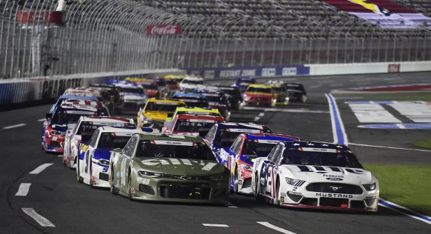 CONCORD, NORTH CAROLINA - MAY 24: Jimmie Johnson, driver of the #48 Ally Patriotic Chevrolet, and Brad Keselowski, driver of the #2 Miller Lite Ford, lead the field on an overtime restart during the NASCAR Cup Series Coca-Cola 600 at Charlotte Motor Speedway on May 24, 2020 in Concord, North Carolina. (Photo by Jared C. Tilton/Getty Images)   Getty Images